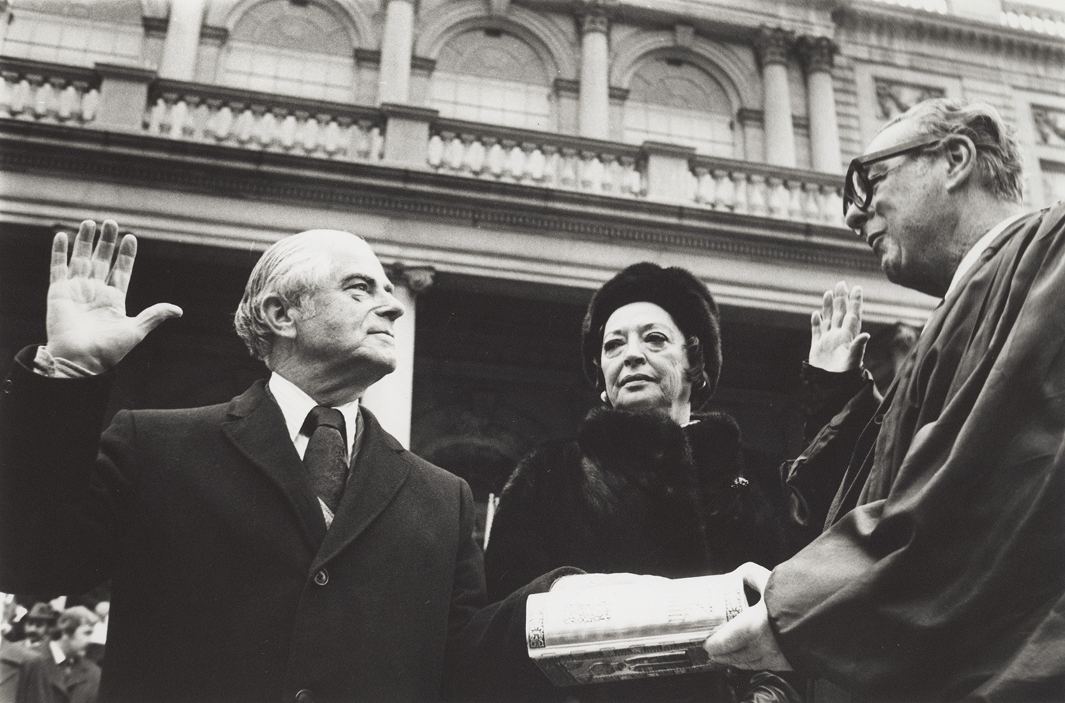 Abraham D. Beame takes the oath besides his wife, January 1, 1974. Photo by Dick De Marsico, Mayor Beame Papers, NYC Municipal Archives.