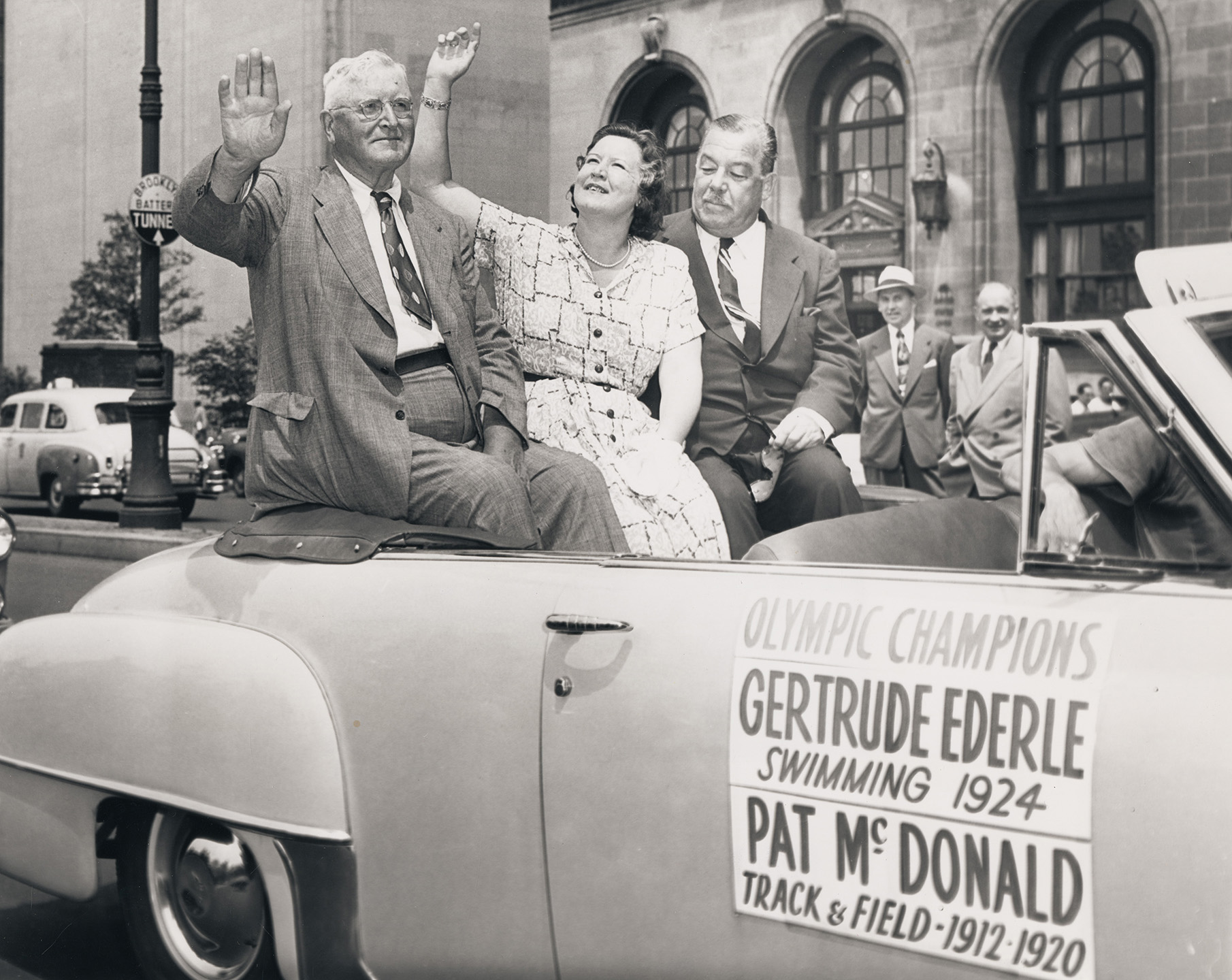 Former Olympic track and field medal winner Pat McDonald, and swimming champion Gertrude Ederle rode with Mayor's Reception Committee Chairman Grover Whalen (at right) in the parade, July 7, 1952.