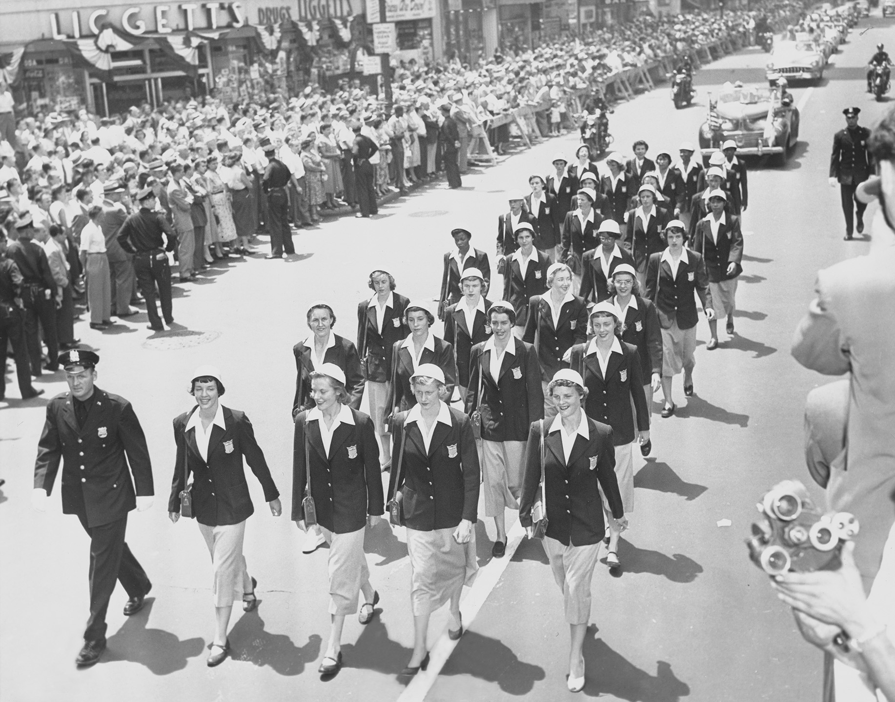 The American women athletes marching up Broadway. July 7, 1952. Mayor's Reception Committe, NYC Municipal Archives.