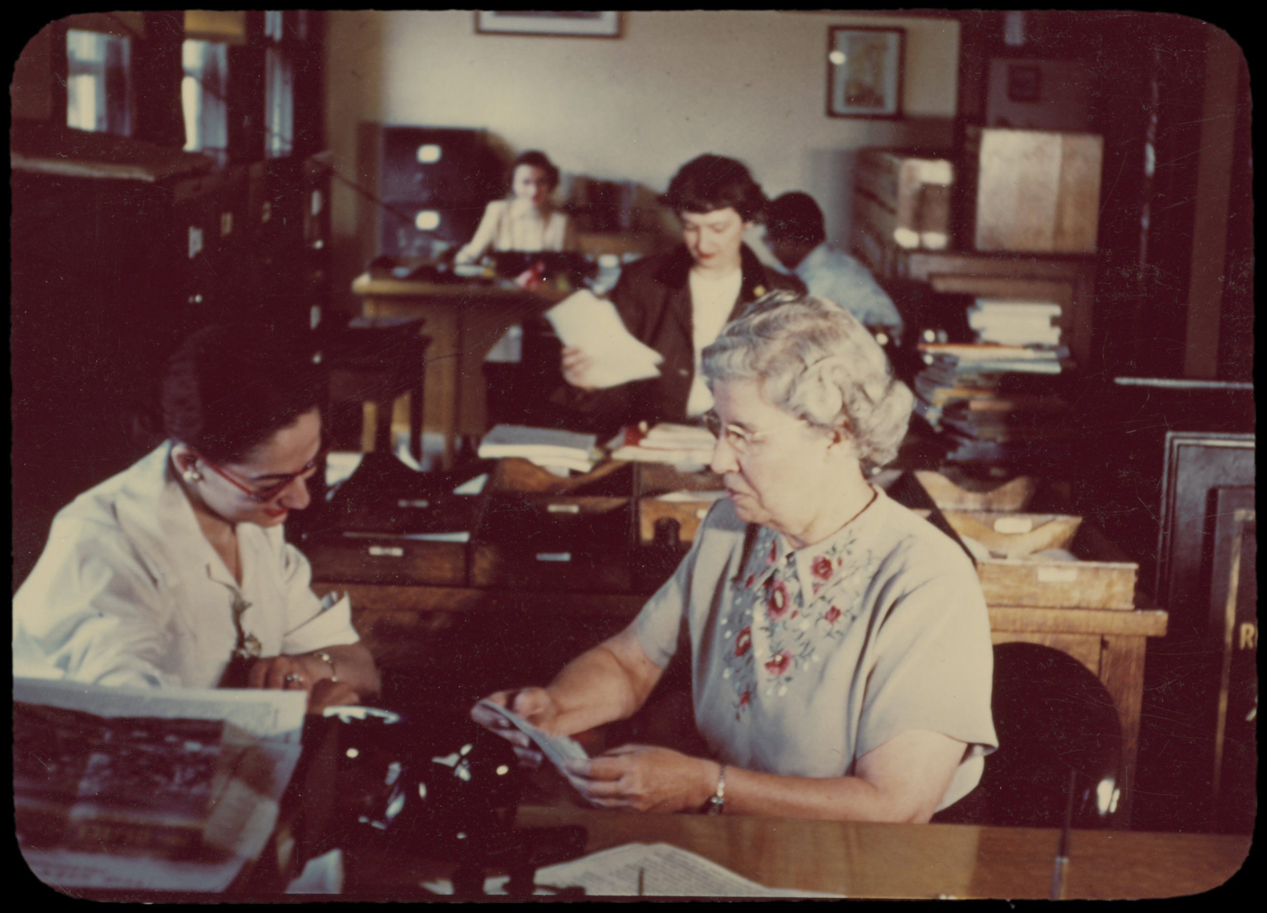 Snapshot of Rankin at work at the Library shortly before her retirement in 1952. Rebecca Rankin Papers, NYC Municipal Archives.