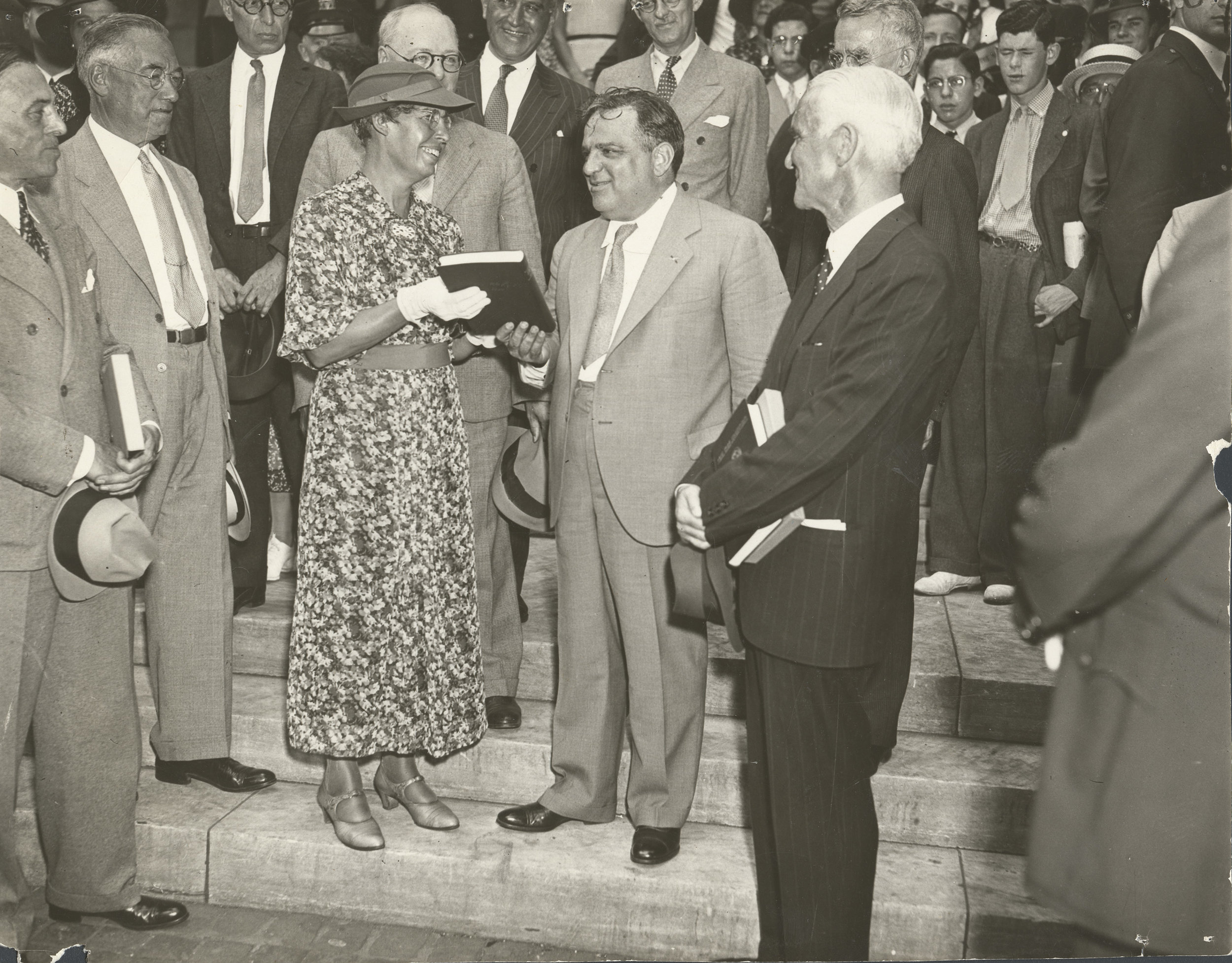 Rebecca Rankin presenting Mayor LaGuardia with the first copy of of her book  New York Advancing  during a ceremony on the steps of the New York Public Library, 1936. Rebecca Rankin Papers, NYC Municipal Archives.