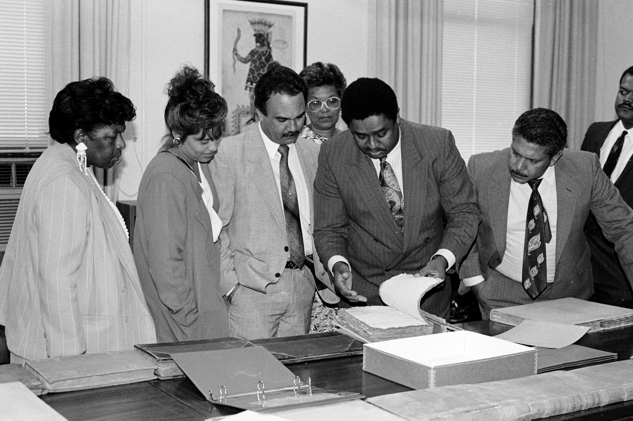 Idilio Gracia Peña showing visitors early City records during an open house, June 7, 1991.