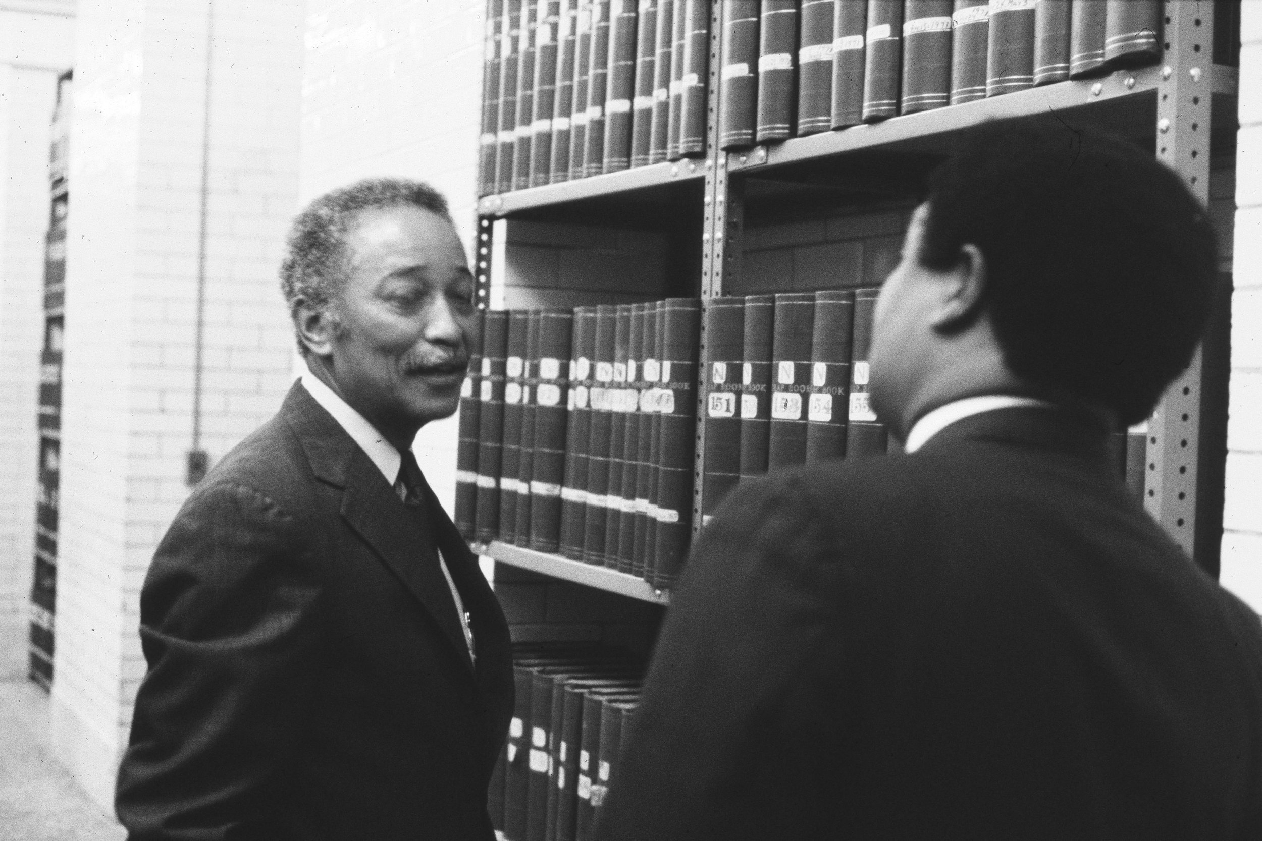 David N. Dinkins with Idilio Gracia Peña in a Municipal Archives storeroom, 1984. At this time Dinkins was City Clerk.