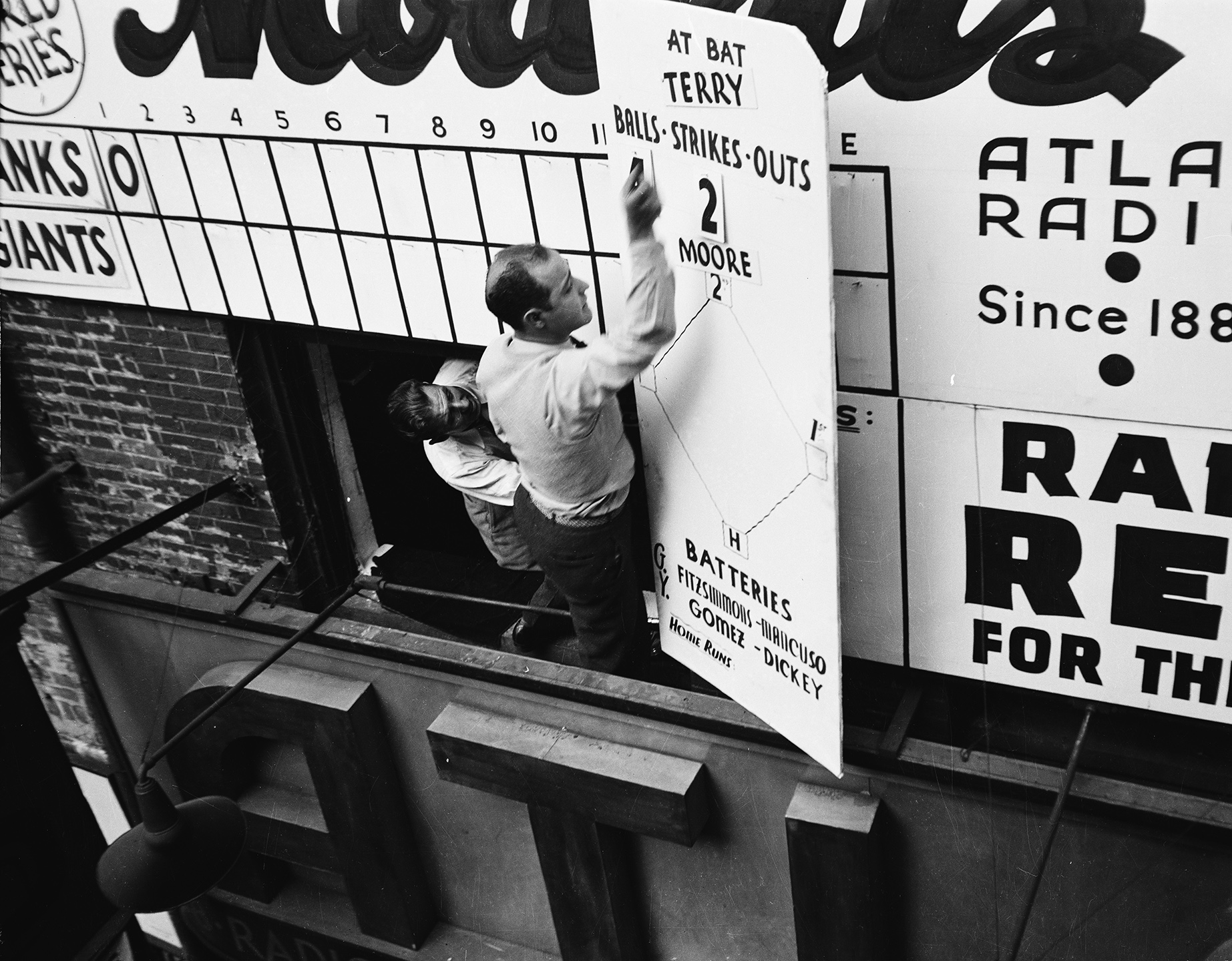 World Series announcement board (Yankees vs. Giants), Radio Row, Cortlandt Street, 1936. WPA Federal Writers' Project, NYC Municipal Archives.