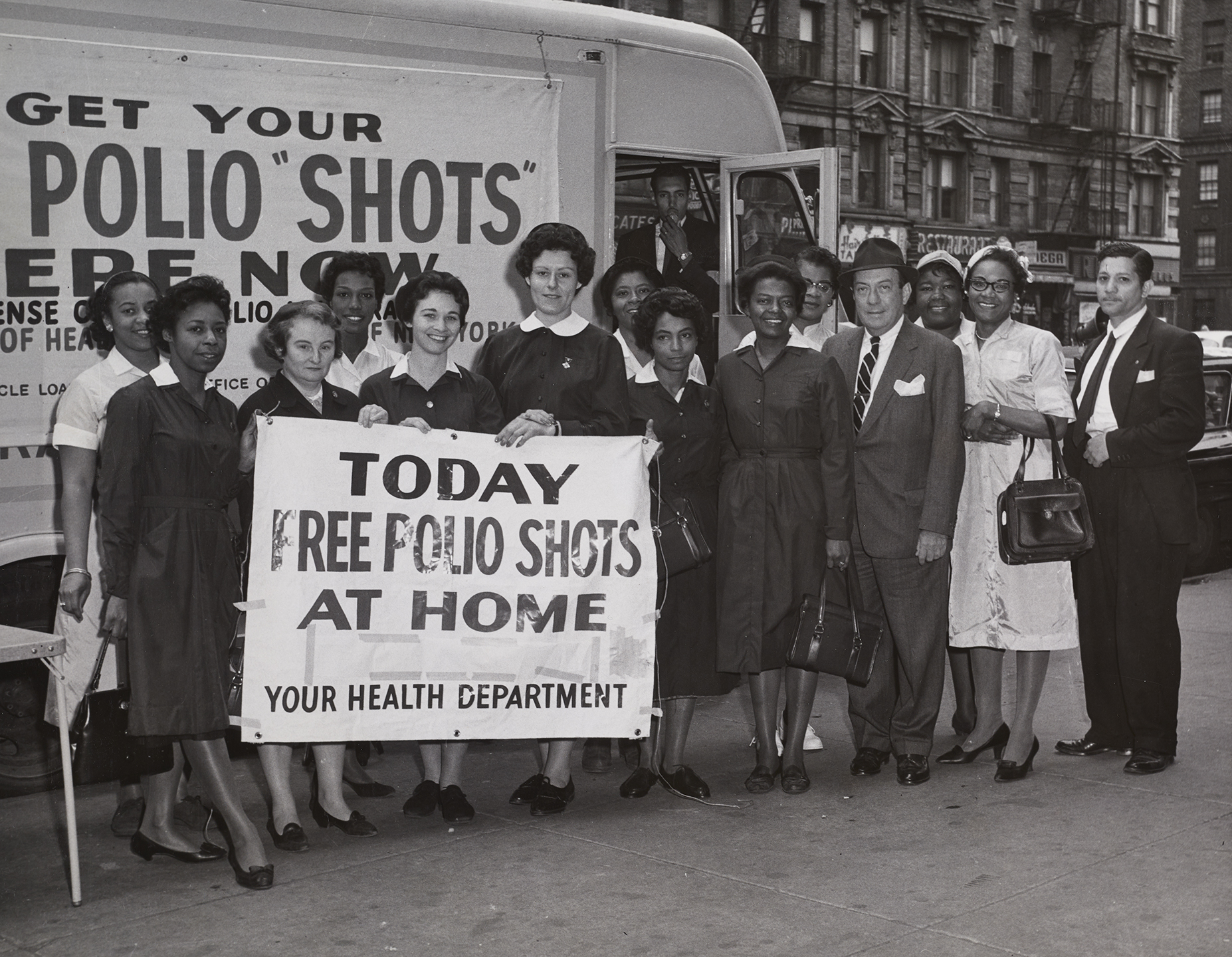 Department staff and volunteers outside mobile vaccine station on 84th Street and Amsterdam Avenue in 1961. Department of Health Collection, NYC Municipal Archives.
