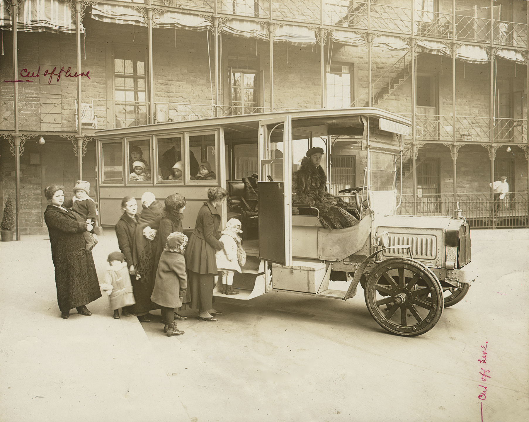 """Mothers and small """"Polio Children"""" board bus, Bellevue Hospital, ca. 1916. Department of Public Charities Collection, NYC Municipal Archives."""