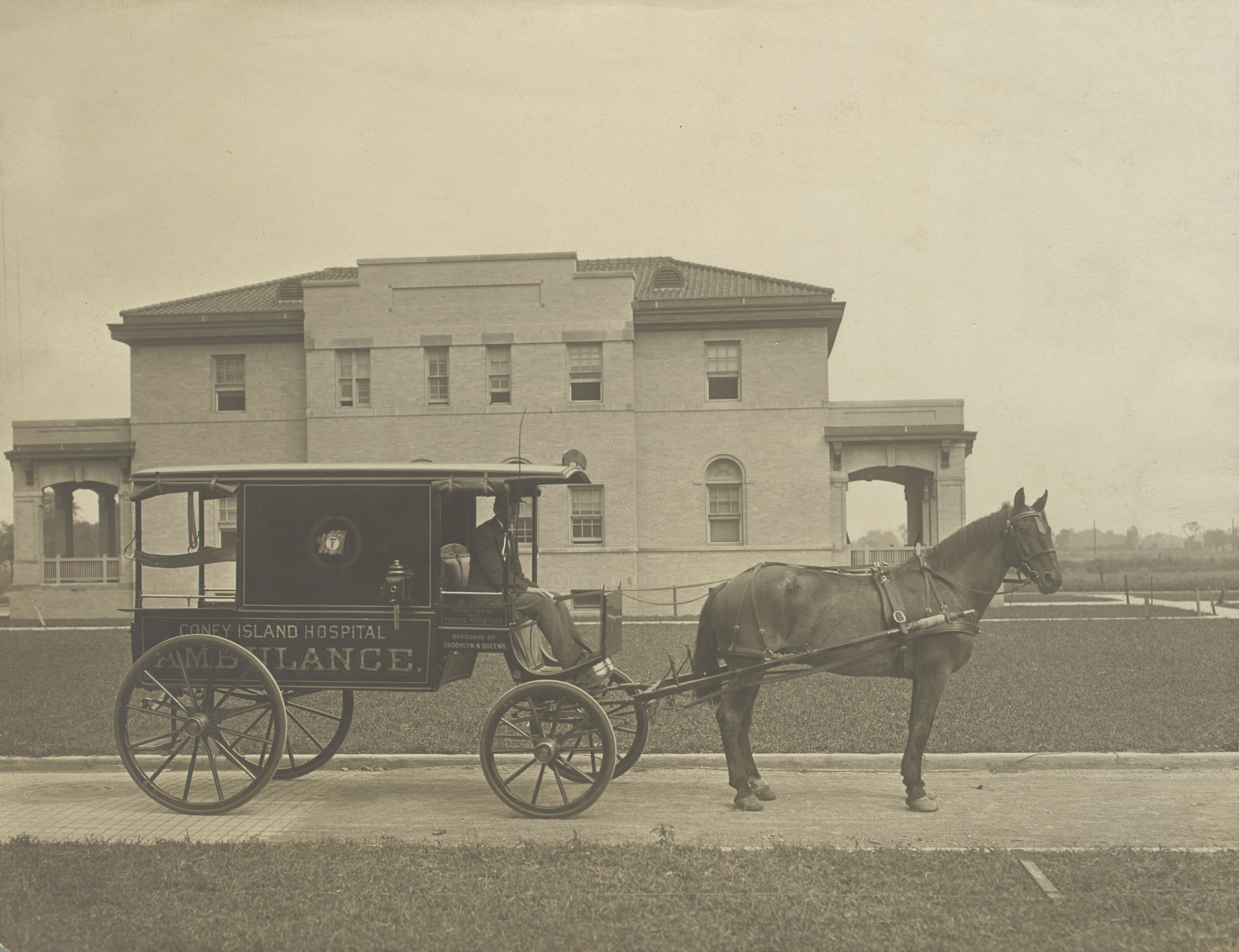 Horse-and-buggy ambulance in front of (Old) Coney Island Hospital, ca. 1900. Department of Public Charities Collection, NYC Municipal Archives.