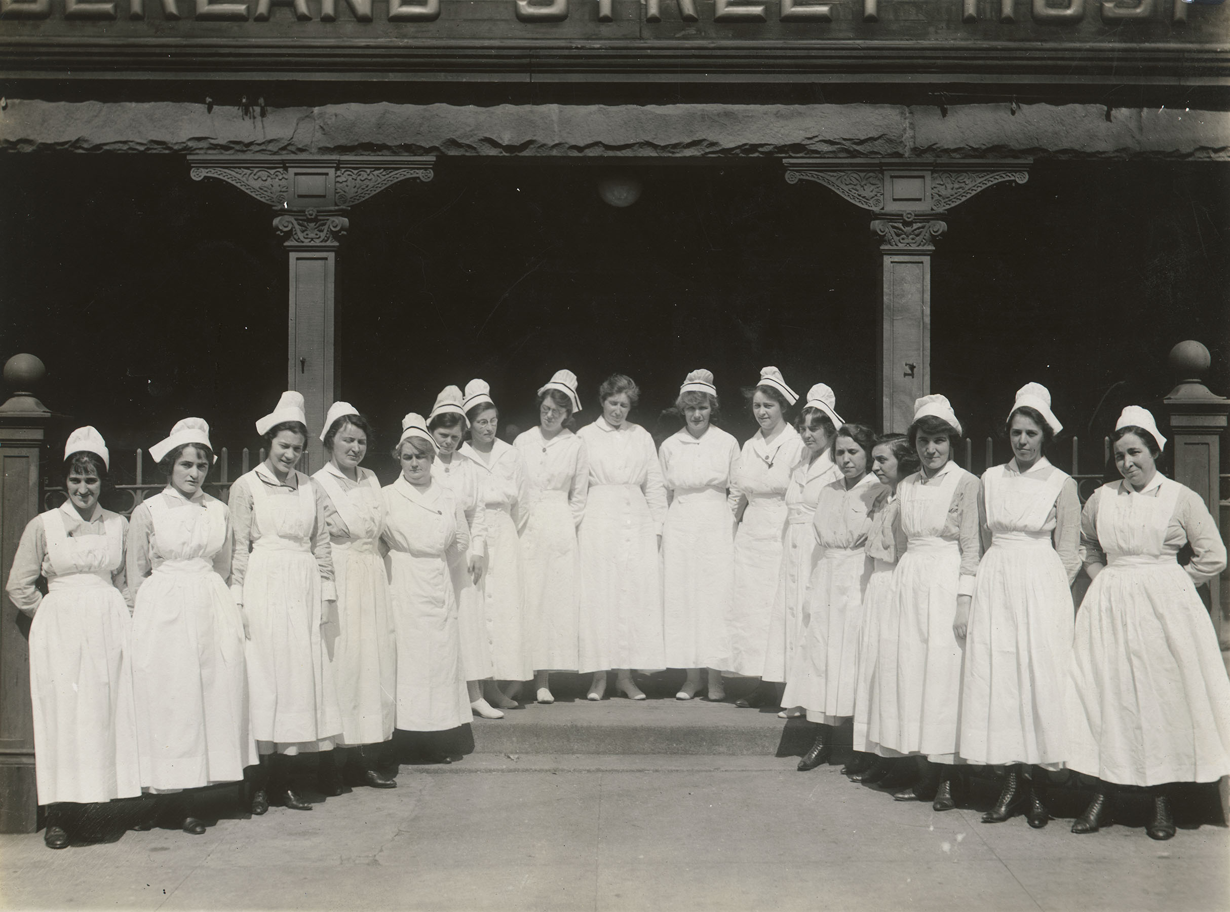 Nurses lined up in front of Cumberland Street Hospital, 1920. Department of Public Charities Collection, NYC Municipal Archives.