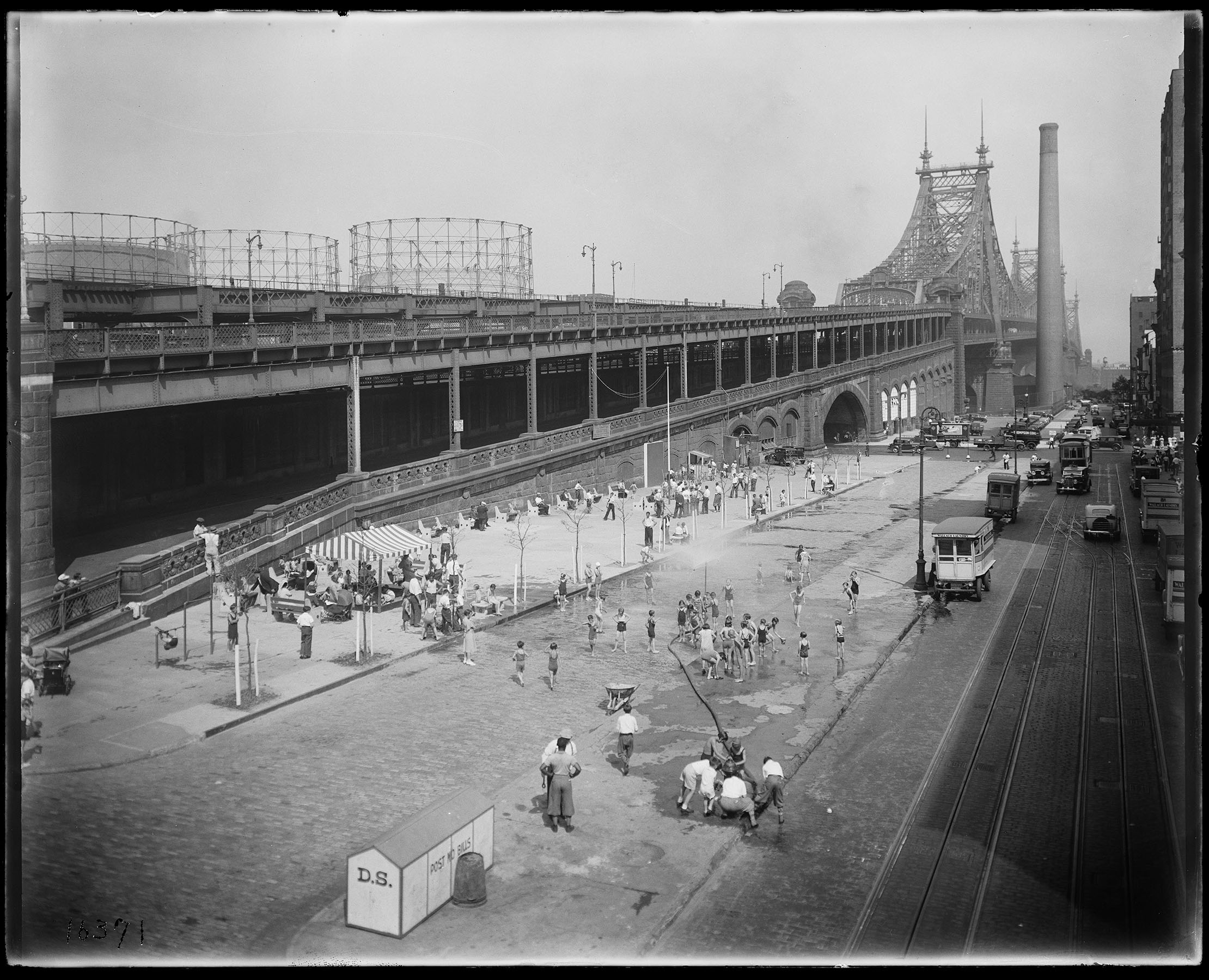 Play Street and street shower alongside the Queensboro Bridge, June 22, 1934. Department of Bridges, Plant & Structures Collection, NYC Municipal Archives.