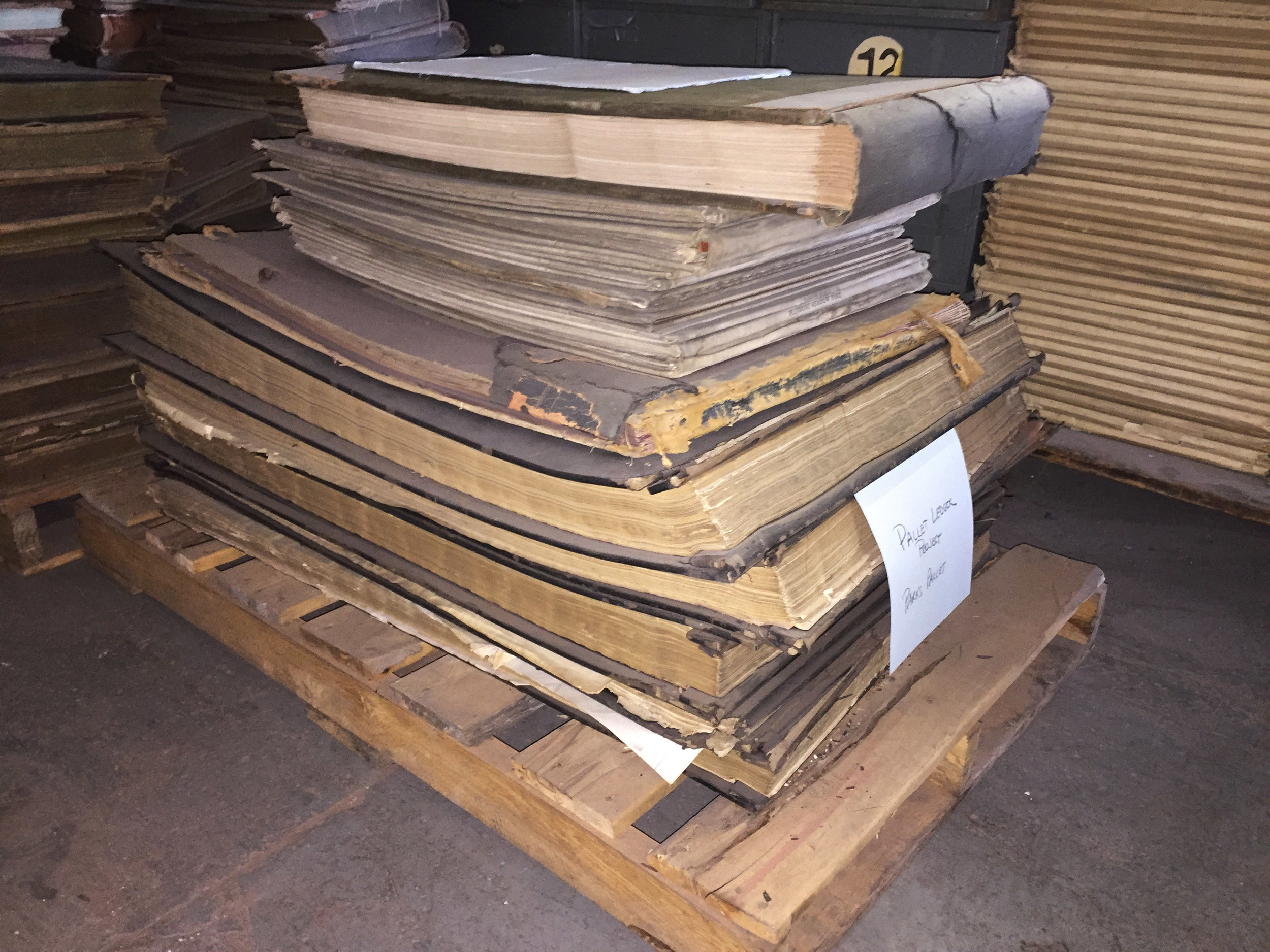 Some of the ledgers saved after a review of pallets at the Municipal Archives warehouse.
