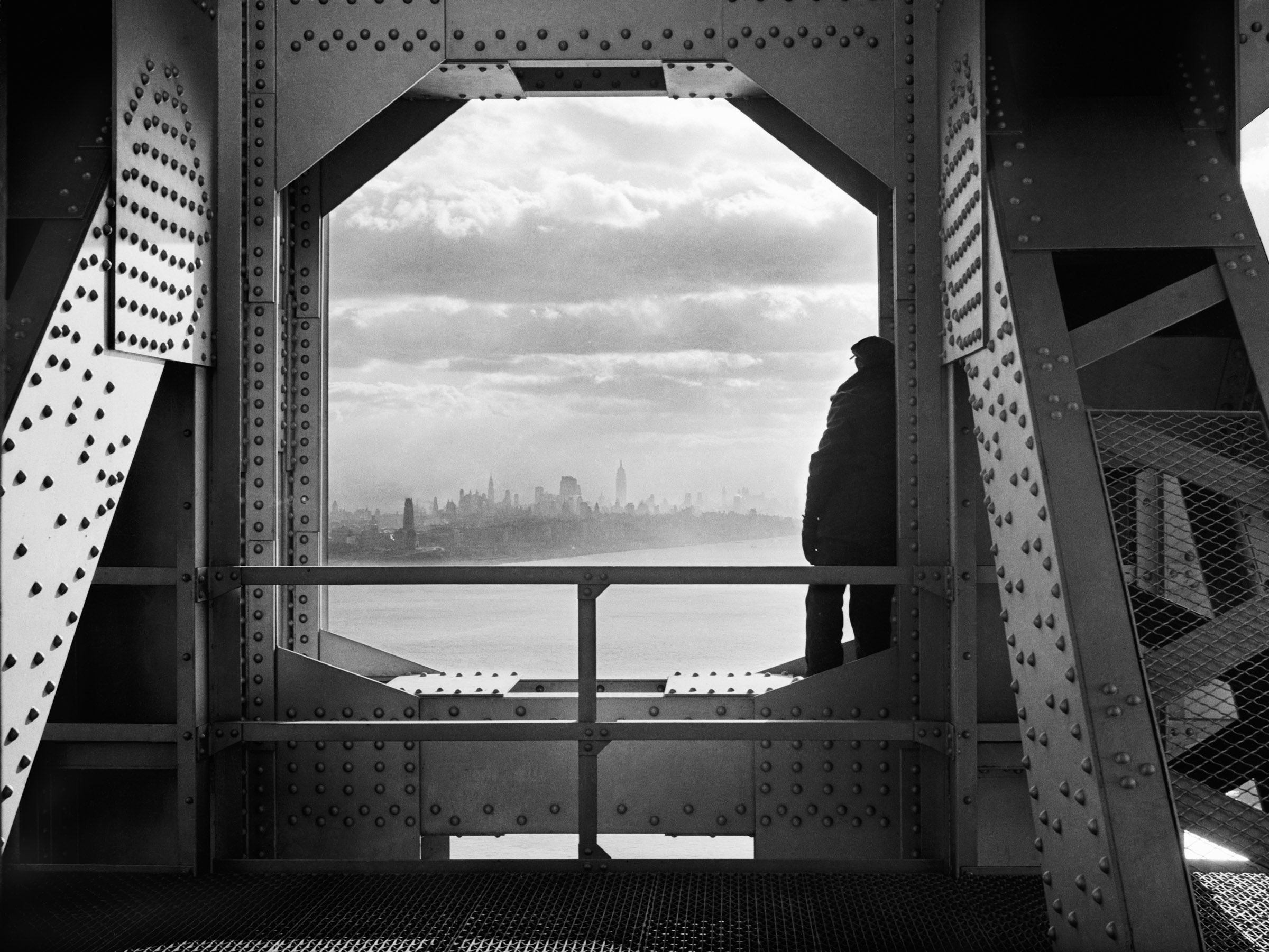 Worker on the New York tower of the George Washington Bridge. Date: December 22, 1936. Photographer: Jack Rosenzwieg. WPA-FWP Collection, NYC Municipal Archives.