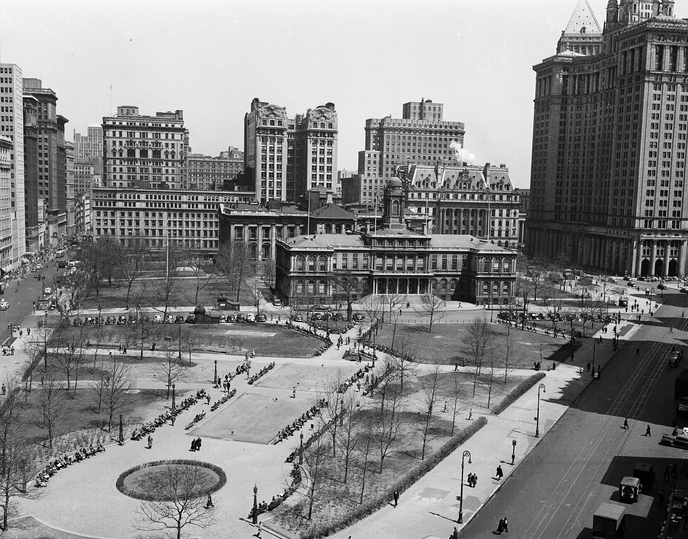 City Hall Park, City Hall, Municipal Building, Surrogate's Courthouse, high view from Park Row, 1950. Department of Public Works Collection, NYC Municipal Archives.