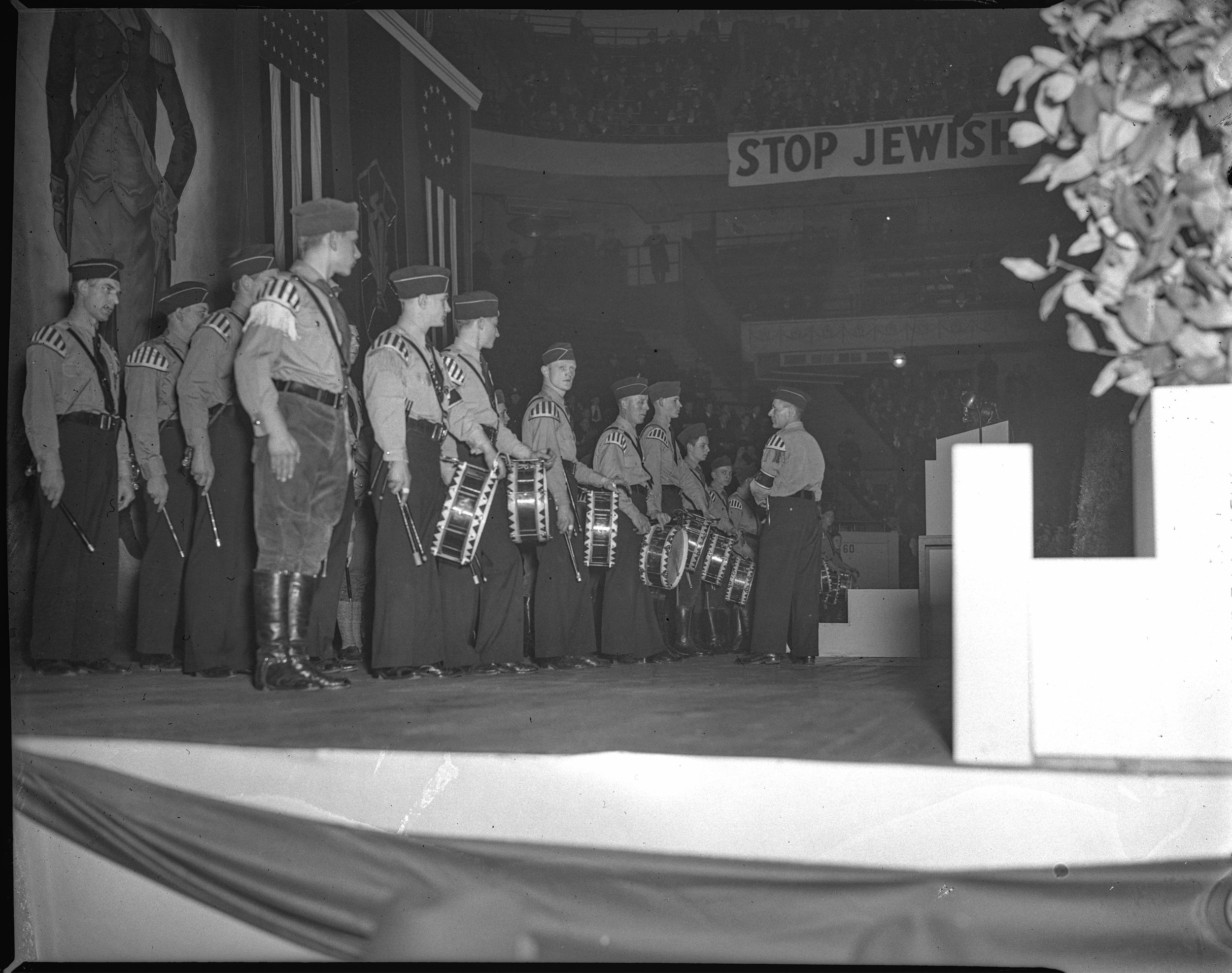 German American Bund members in Madison Square Garden, February 20th, 1939 with a banner of George Washington behind them. NYPD_22066j, NYPD Collection, NYC Municipal Archives.