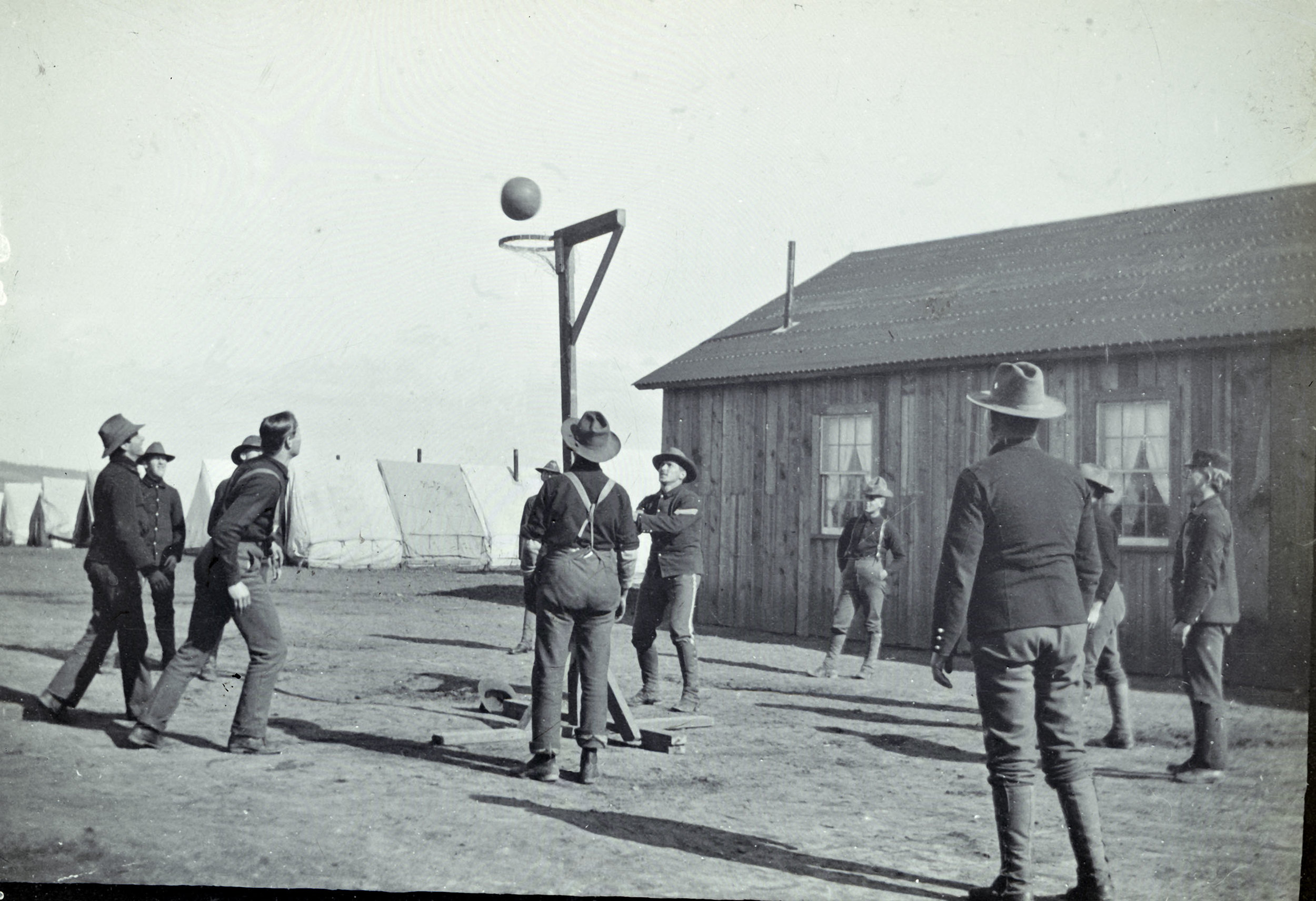 BPQ_ls_138: Soldiers playing basketball at mobilization camp for Spanish-American War, ca. 1896-1898. Note the lack of a backboard. Borough President Queens Collection, NYC Municipal Archives.