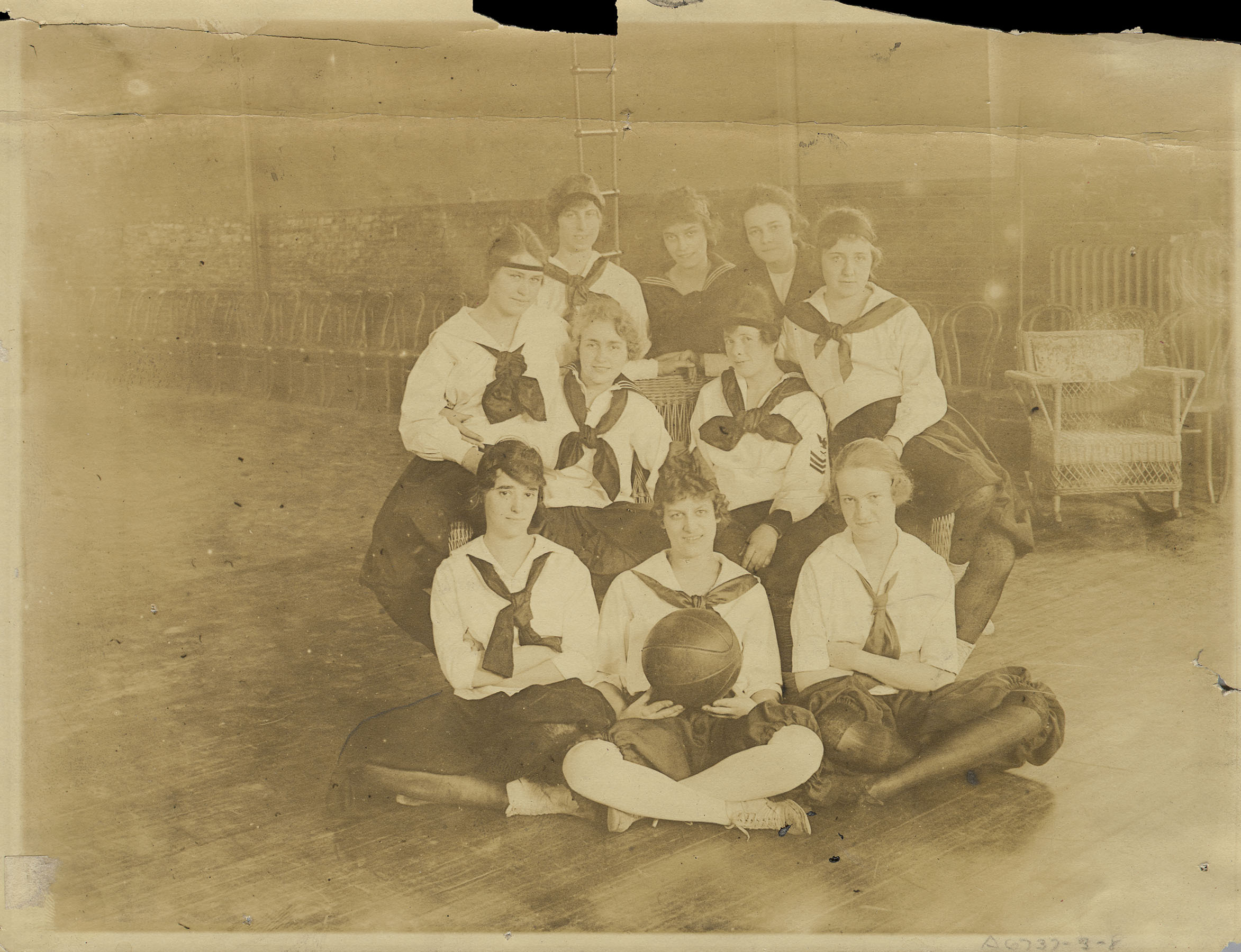 DPC_1424: Kings County Hospital: Nurses' basketball team posing for camera wearing their uniforms, ca. 1920. Department of Public Charities Collection, NYC Municipal Archives.