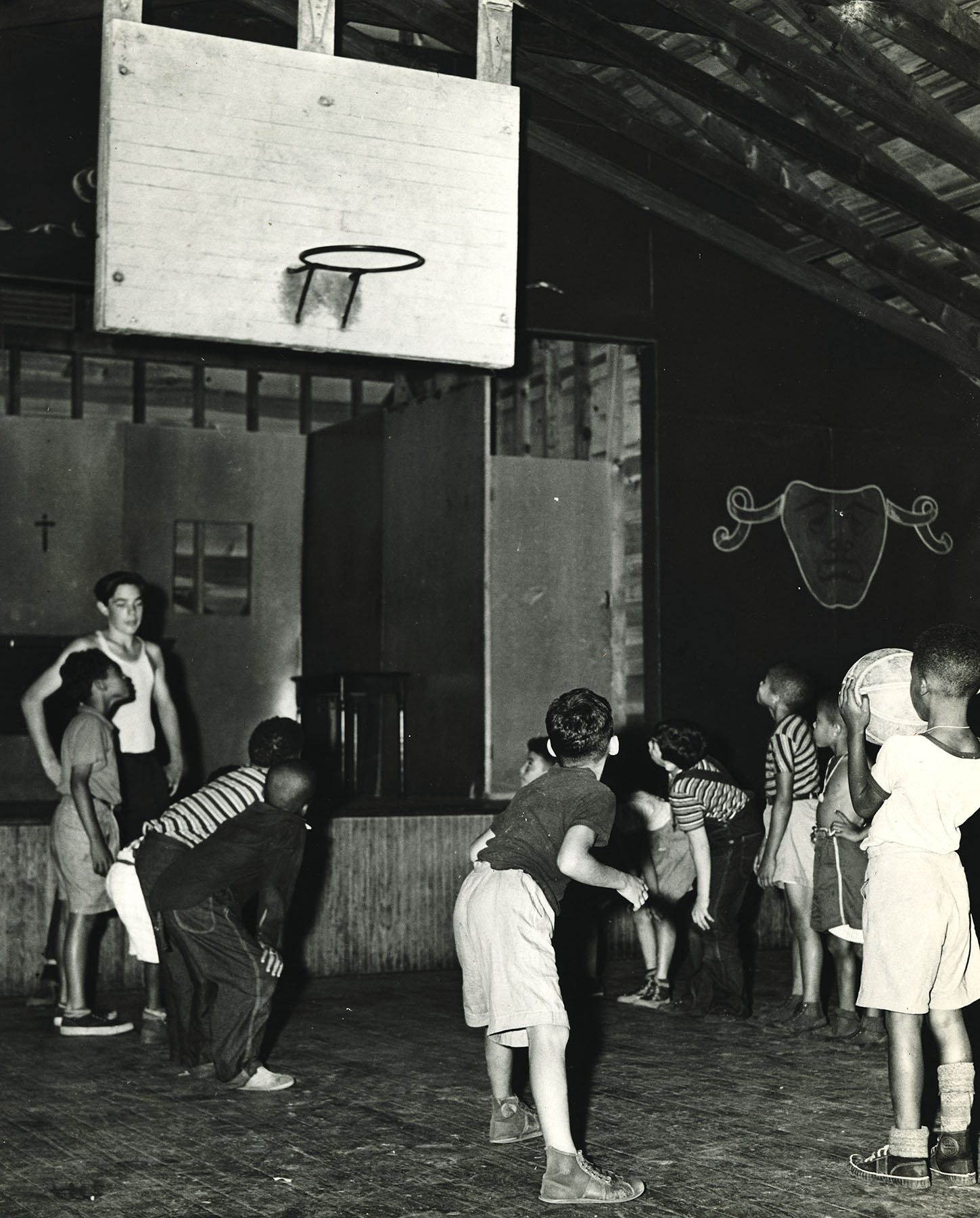 FHL_0772: Children playing Basketball, Catholic Youth Organization, Heckscher Camp, September 1942. Mayor LaGuardia Collection, NYC Municipal Archives.