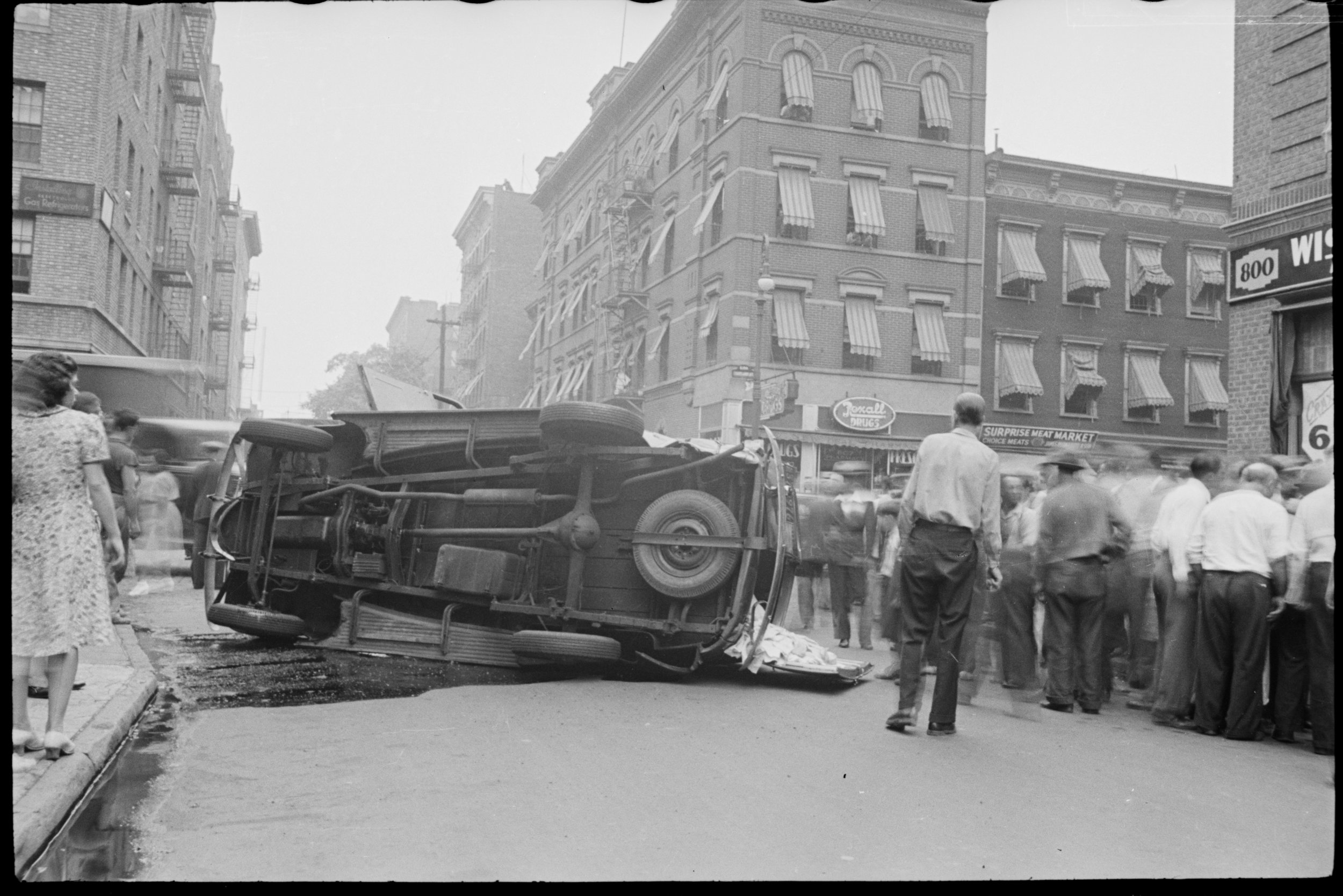 An accident scene in the Bronx captured by an anonymous Tax Photo photographer, ca. 1940.