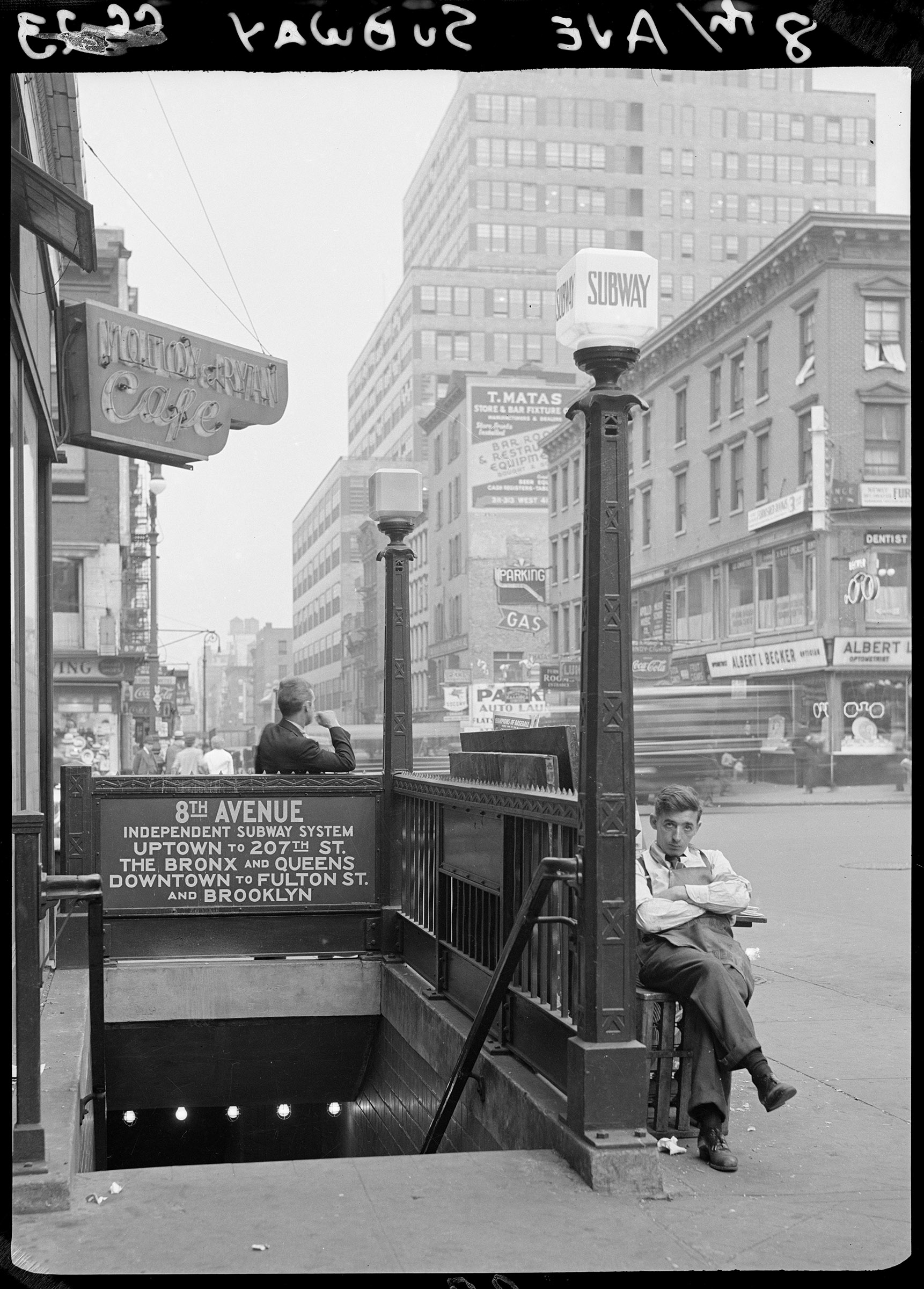 Newspaper vendor at entrance to 8th Avenue Subway, ca. 1937. Photographer unknown, WPA Federal Writers' Project collection, NYC Municipal Archives.