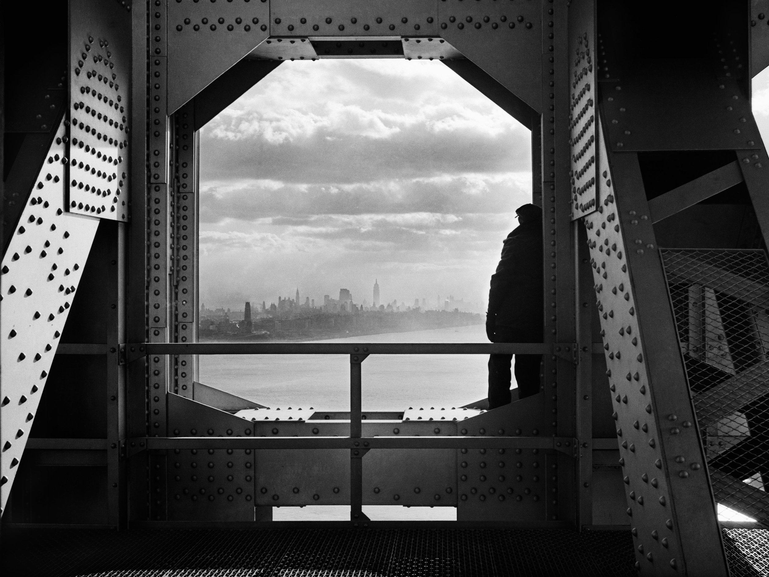 Worker on the New York tower of the George Washington Bridge, December 22, 1936. Photograph by Jack Rosenzwieg, WPA Federal Writers' Project collection, NYC Municipal Archives.