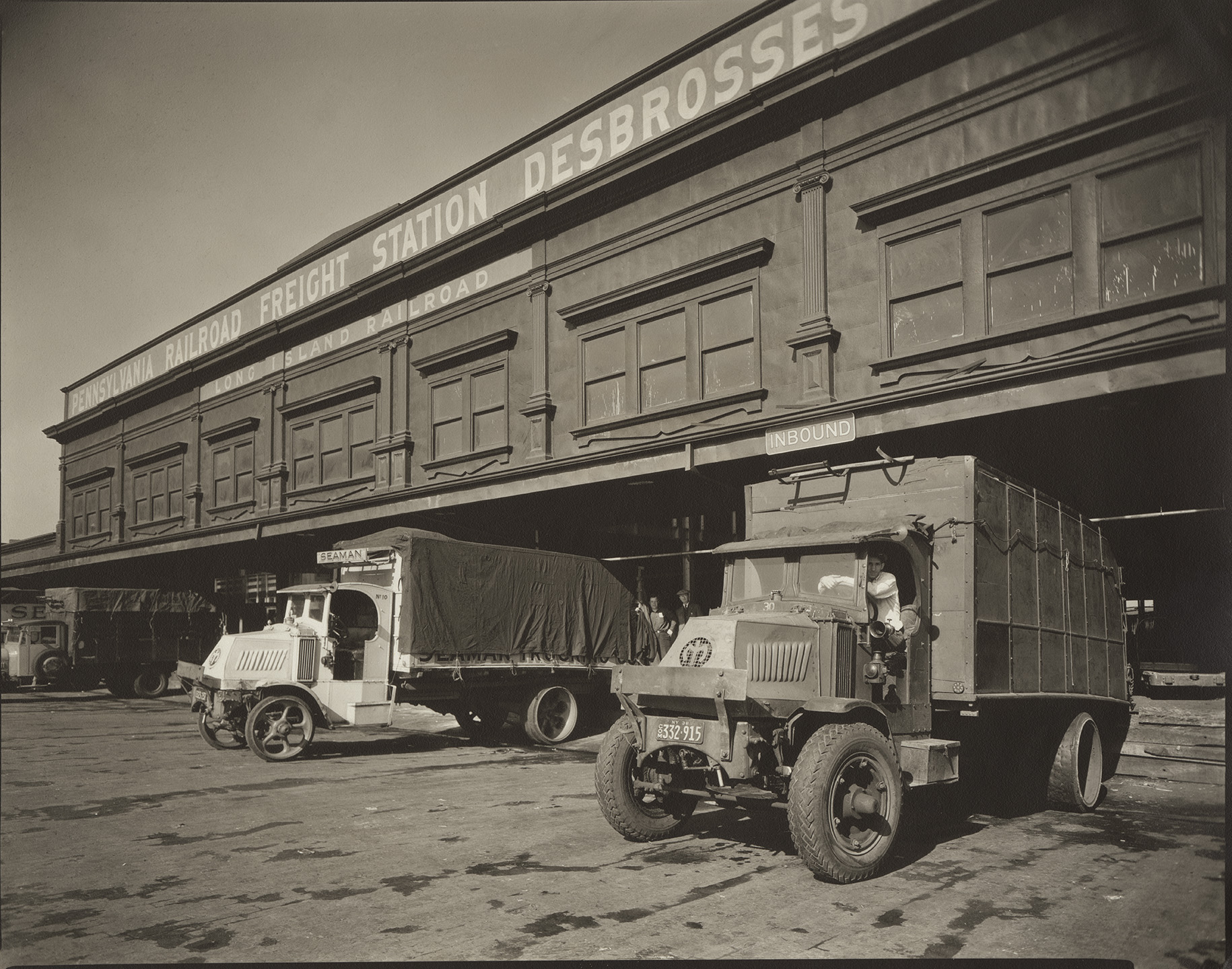 Trucks, West and Debrosses Streets, June 18, 1936. Photograph by Berenice Abbott, WPA Federal Writers' Project collection, NYC Municipal Archives.