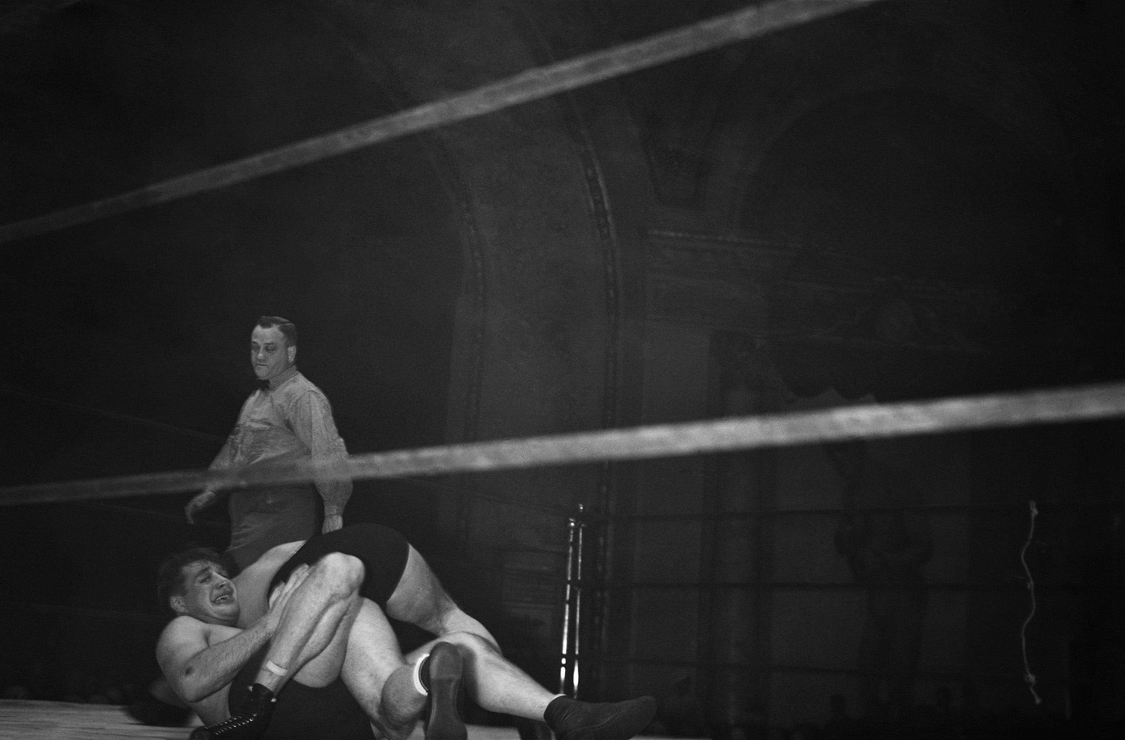 Referee watching wrestlers in the Hippodrome, 6th Avenue and 43rd Street, ca. 1938. Photographer unknown, WPA Federal Writers' Project collection, NYC Municipal Archives.