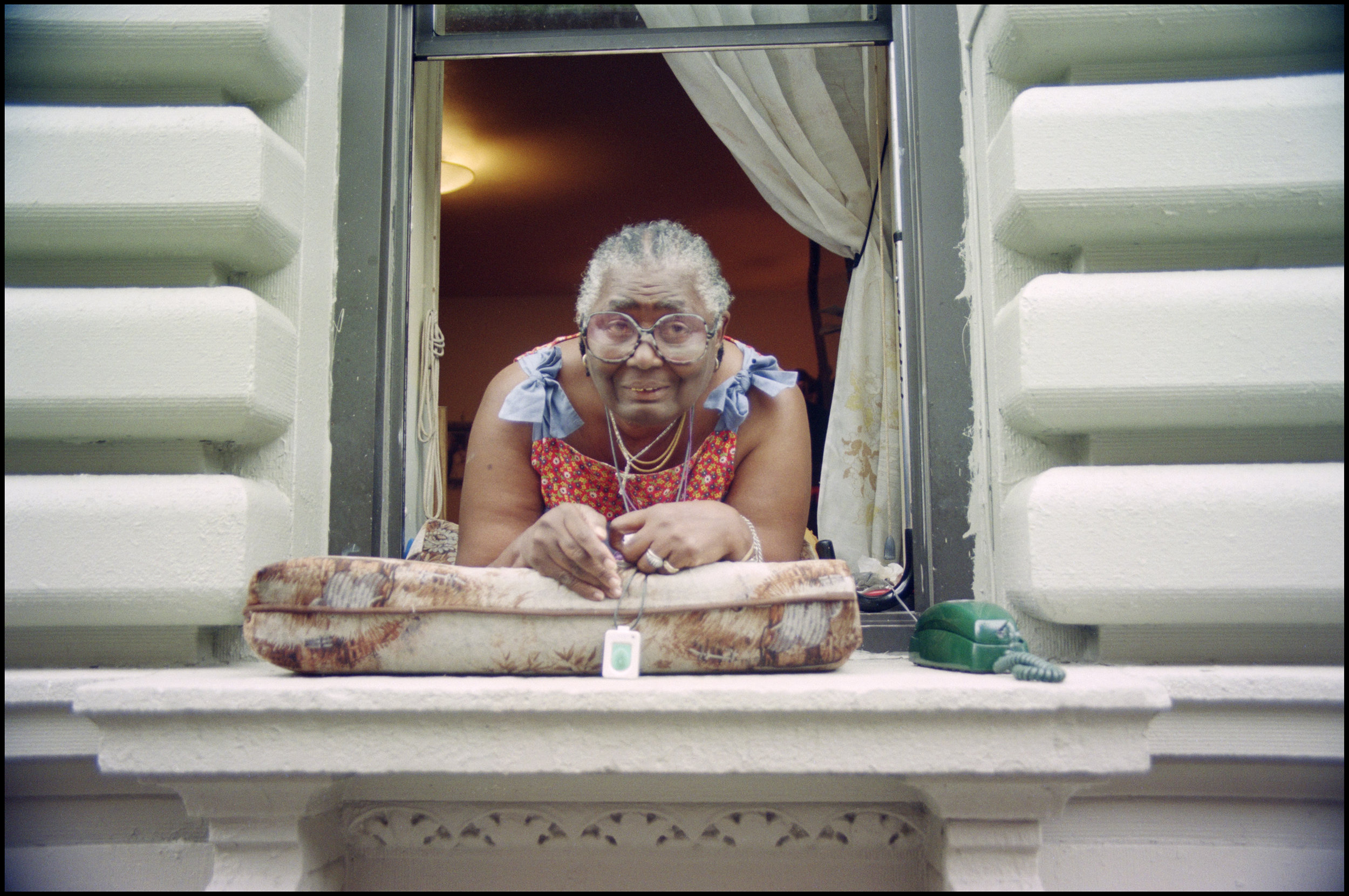 Tenant in window, location unknown. September 1996. Photograph by Larry Racioppo.