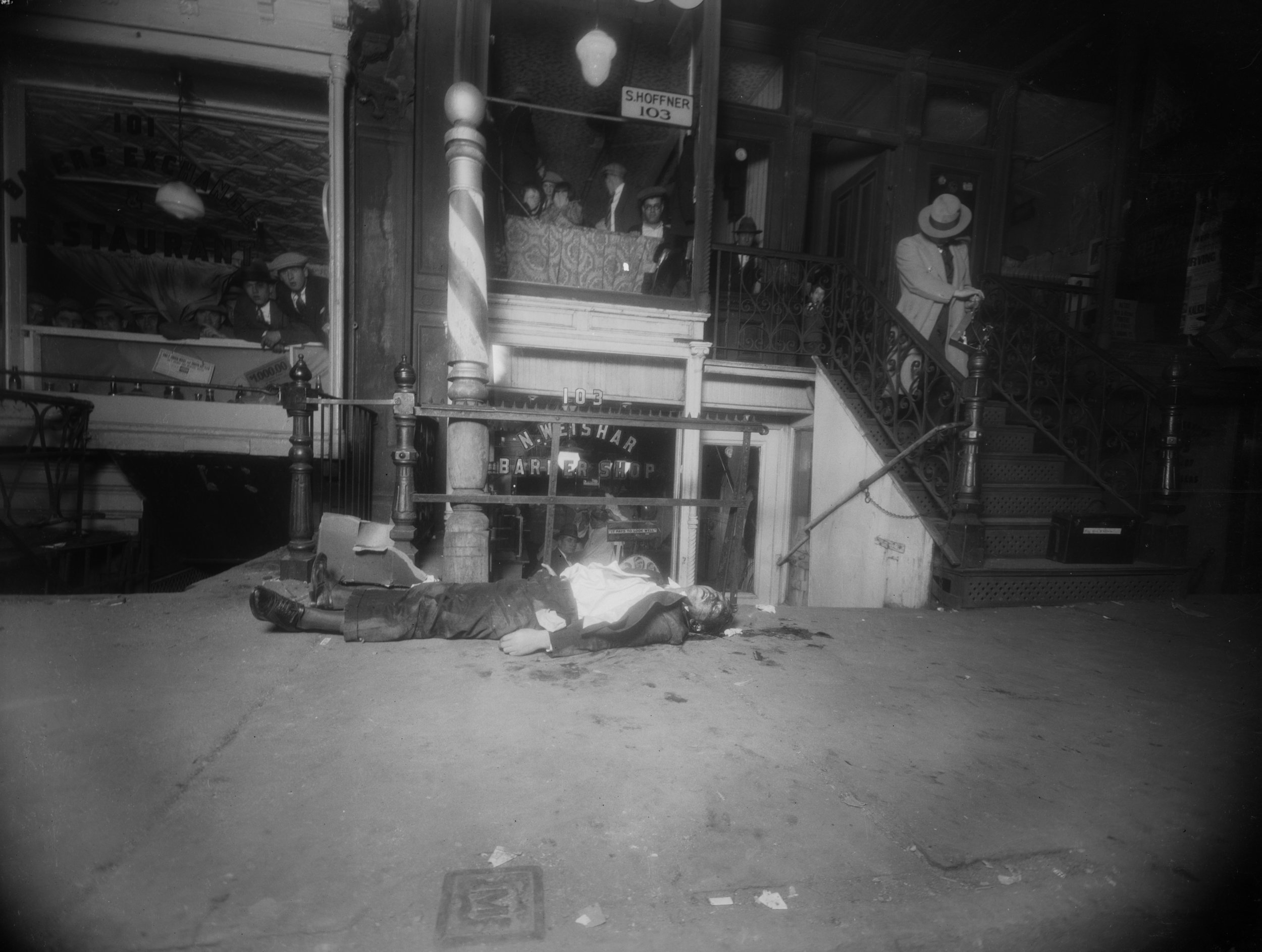 NYPD 9348b: Photo of body and scene where Jacob Orgen, alias Little Augie, was shot and killed in front of 103 Norfolk St., Manhattan while in the company of Jack Diamond, October 15, 1927. George B. Nolan, NYPD Collection, NYC Municipal Archives.