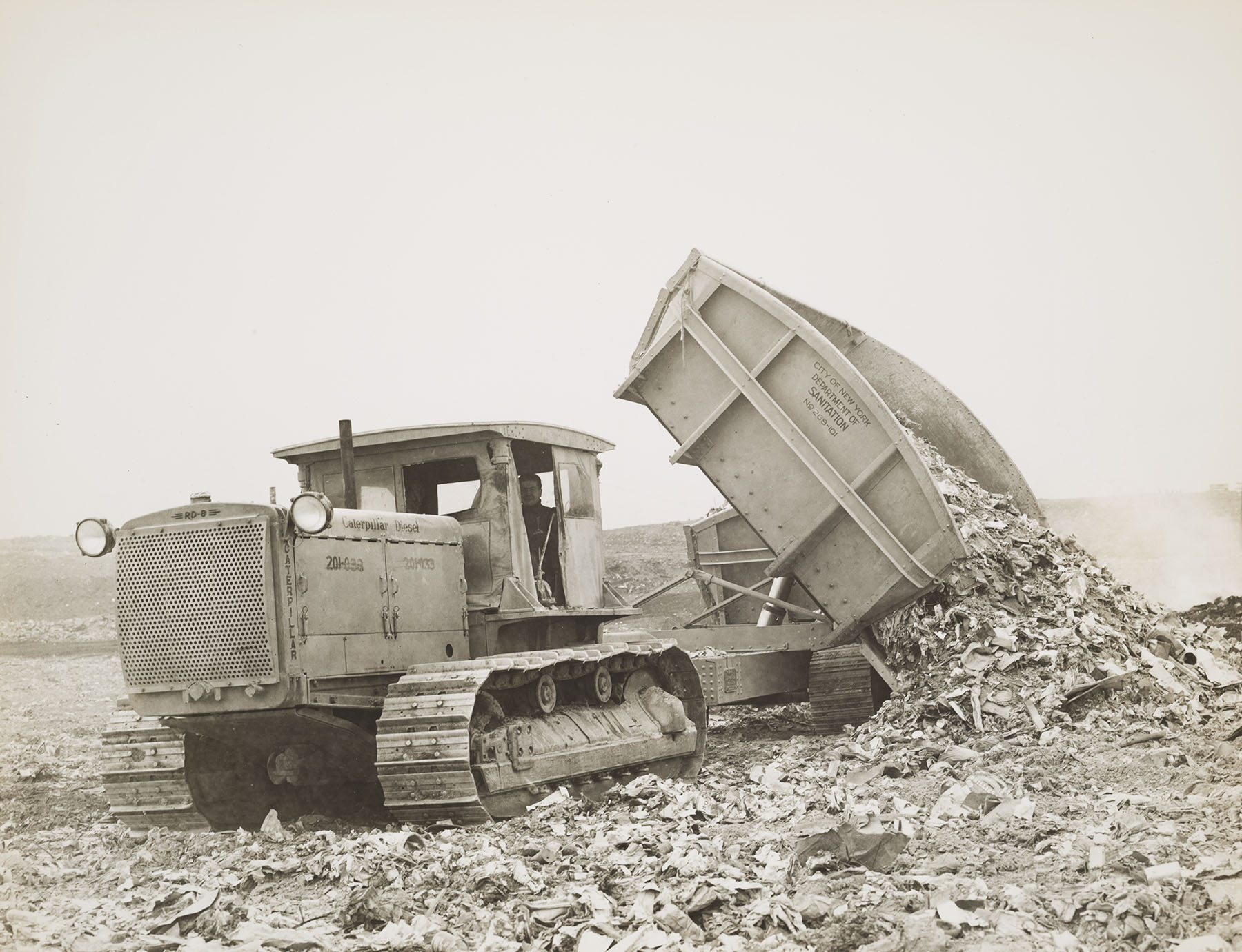 MAC_1058: Department of Sanitation tractor at Rikers Island Dump, ca. 1936. NYC Municipal Archives.