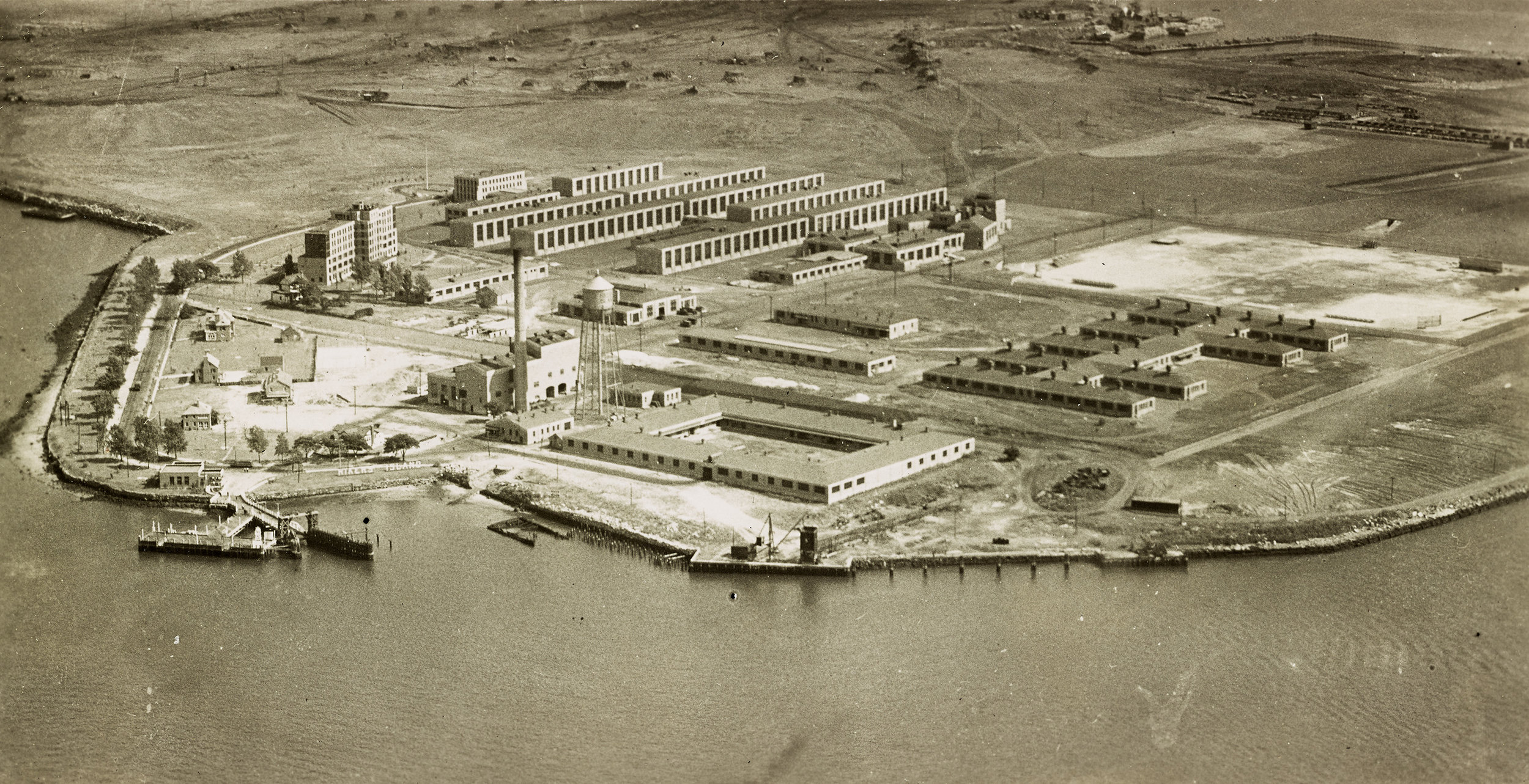 MAC_1935: Aerial view of unfinished Rikers Island penitentiary buildings, ca. 1936. Department of Corrections, NYC Municipal Archives Collection.