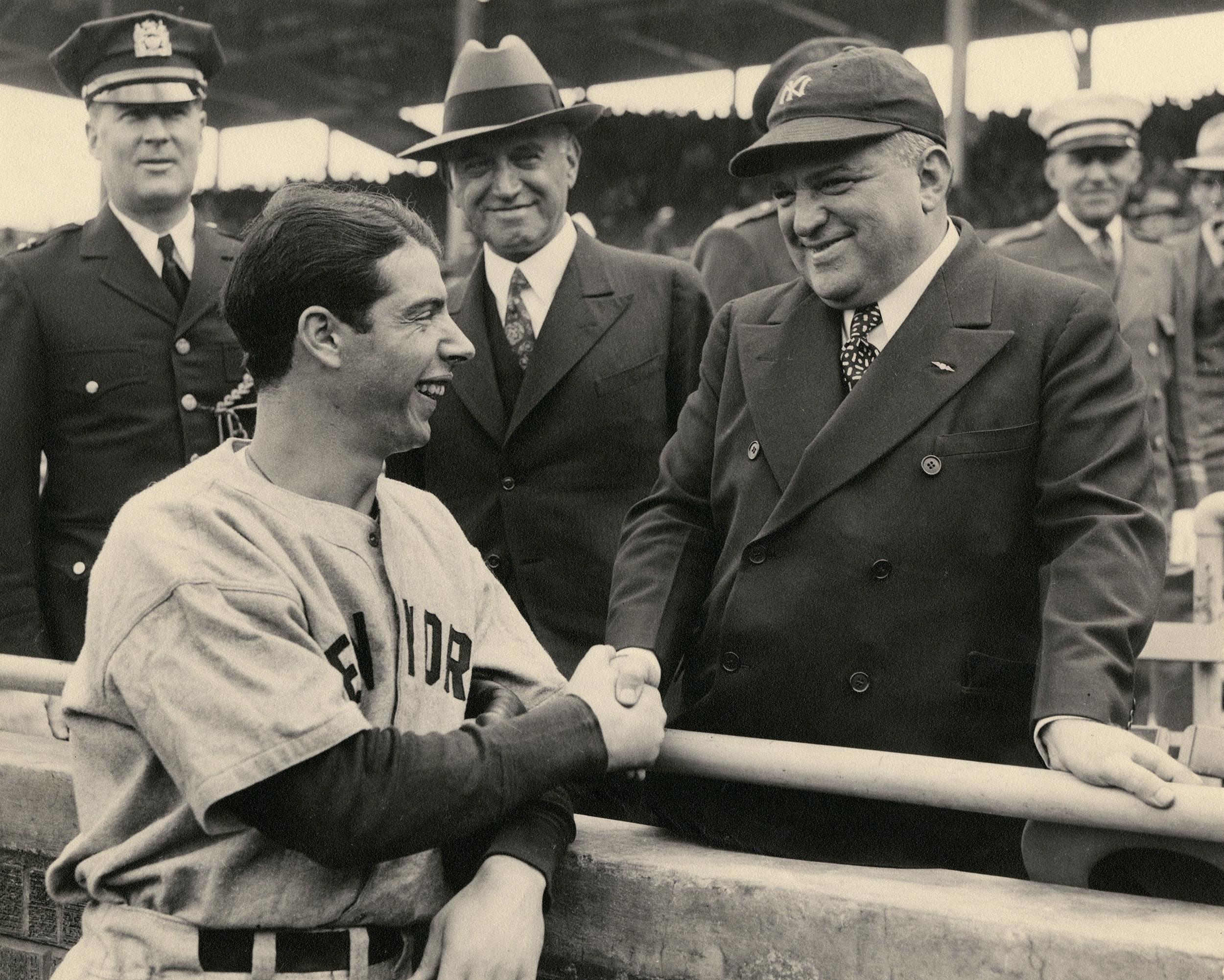 Joe DiMaggio shakes hands with Mayor Fiorello H. LaGuardia, before the start of the 1938 World Series at Wrigley Field.  Order Now.