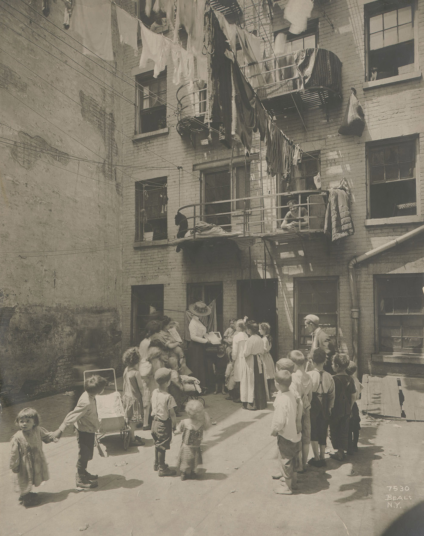 Visiting Nurse in tenement backyard, Jessie Tarbox Beals, ca. 1912.