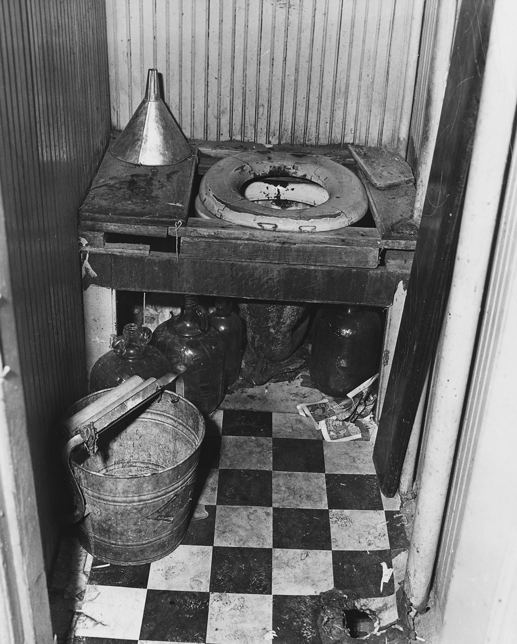 Shared toilet in tenement building, n.d. Credit Cosmo-Sileo. NYC Municipal Archives Collection.