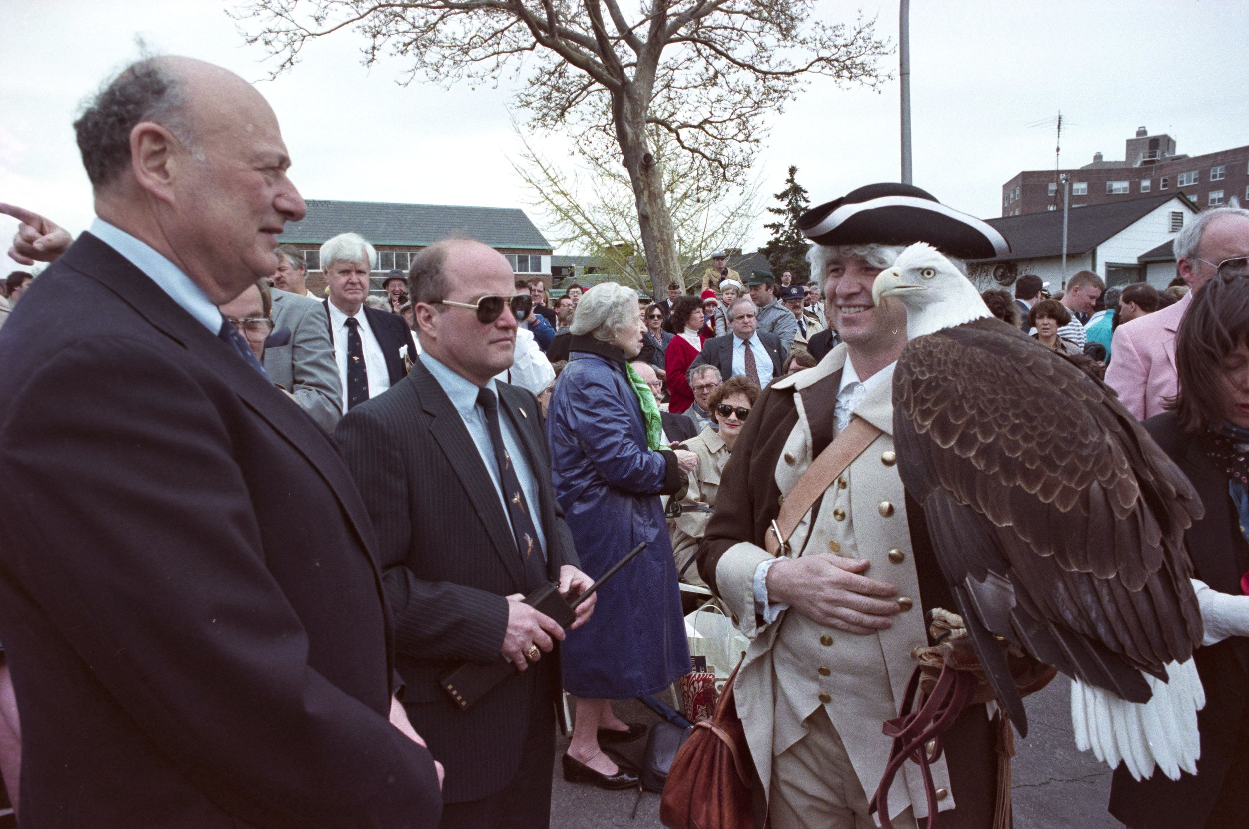 Mayor Edward Koch meets an eagle at Fleet Week 1989 ceremonies on Governors Island, April 29, 1989, roll 1, frame 24A, photographer Joan Vitale Strong. Mayor Edward I. Koch Collection, NYC Municipal Archives.