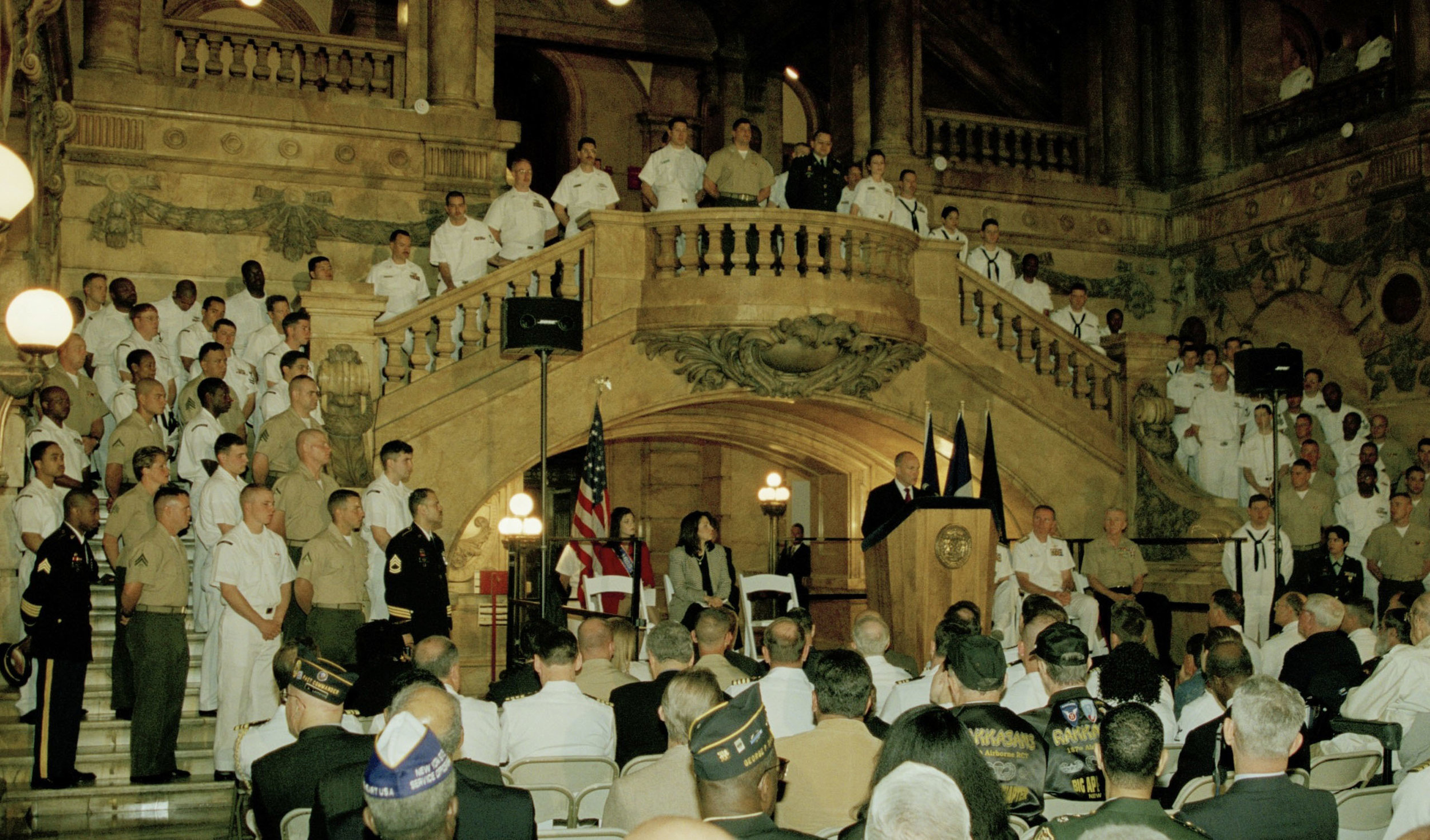 Police Commissioner Ray Kelly addresses Fleet Week visitors in the central lobby at 31 Chambers Street on May 22, 2002. Mayor Michael R. Bloomberg Collection, NYC Municipal Archives.
