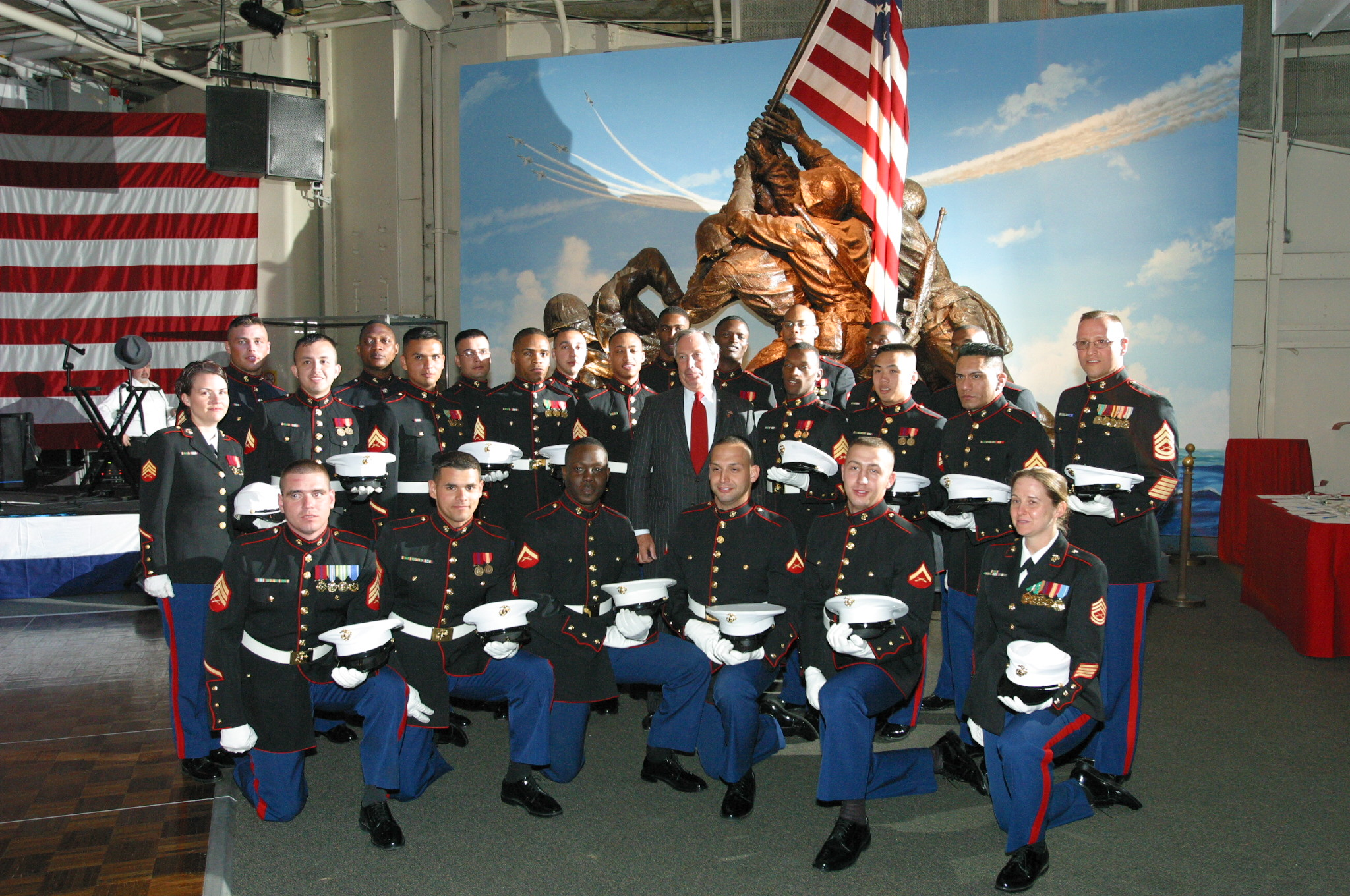 Mayor Michael Bloomberg poses with U. S. Marine Corps men and women at the Intrepid Air and Space Museum on May 23, 2001. Mayor Michael R. Bloomberg Collection, NYC Municipal Archives.