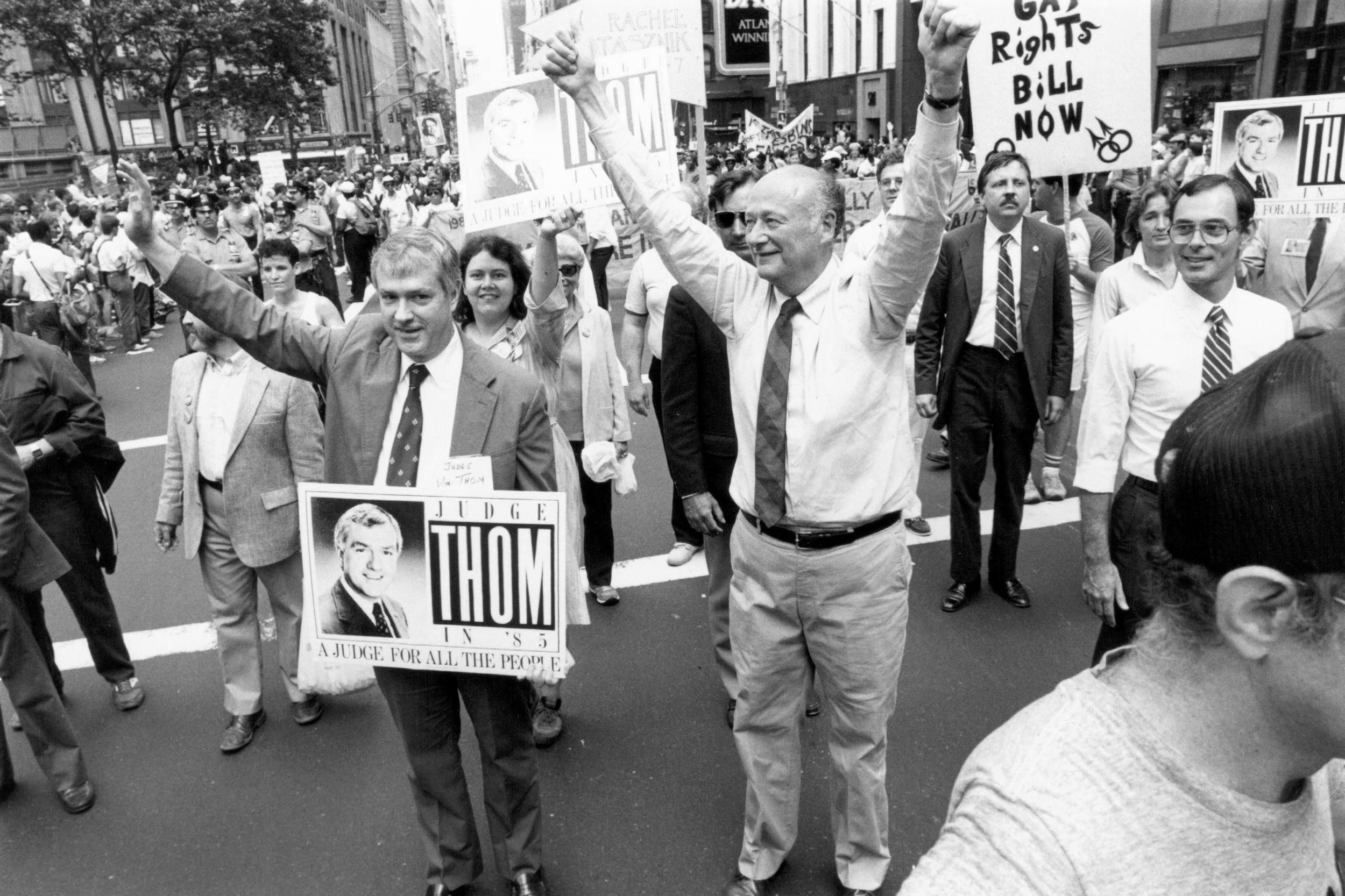 Mayor Edward Koch marched in the 1985 Gay Pride parade with Judge Willliam Thom, New York's first openly gay judge. June 30, 1985. Photographer: Holland Wemple. Edward I. Koch Collection, NYC Municipal Archives.