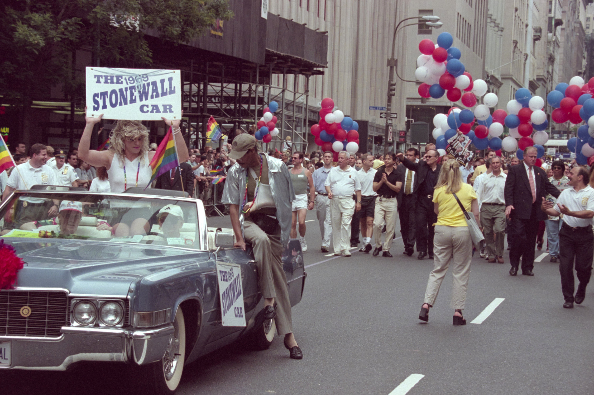 "Giuliani's photographers recorded his participation in the 1995, 1996, 2000 and 2001 Gay Pride parades. During the 2001 march on June 24, 2001, Giuliani was joined by the then candidate-for-mayor Michael Bloomberg. The ""Stonewall Car"" is a 1969 Cadillac Coupe de Ville convertible. Photographer: Edward Reed. Mayor Rudolph W. Giuliani Collection, NYC Municipal Archives."