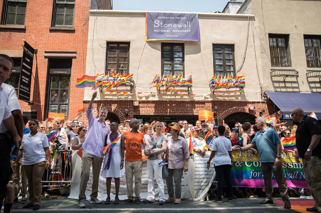 During the 2016 Pride festivities, Mayor Bill de Blasio and first lady Chirlane McCray, with Al Sharpton and Cynthia Nixon stand before the Stonewall Inn, June 26, 2016. Photographer: Michael Appleton. On June 24, 2016, President Obama had dedicated the Stonewall National Monument as the first official National Park Service unit dedicated to telling the story of LGBT Americans. June 26, 2016