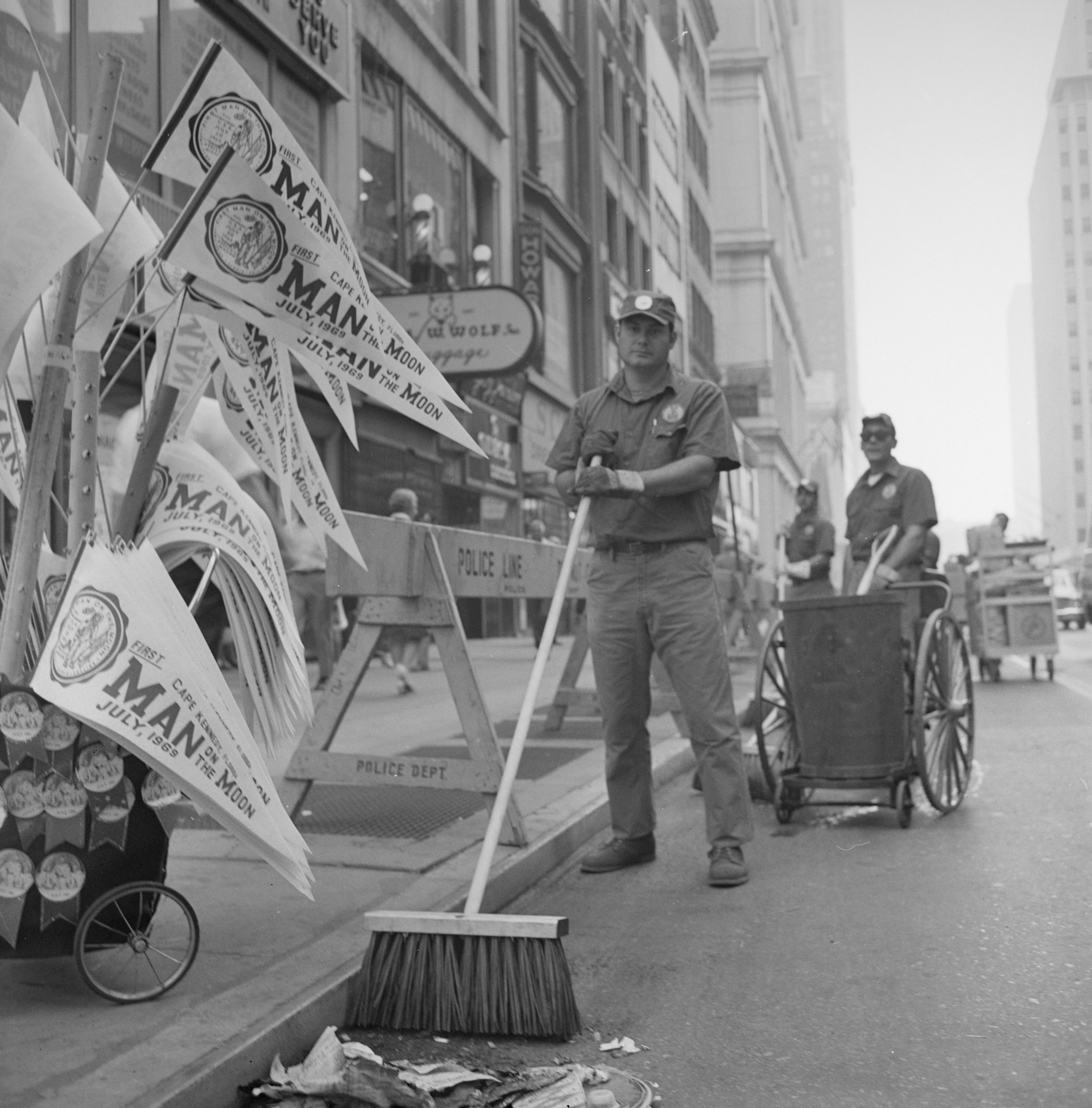 Sanitation workers cleaning the parade route along Broadway, August 13, 1969. Department of Sanitation Collection, NYC Municipal Archives.