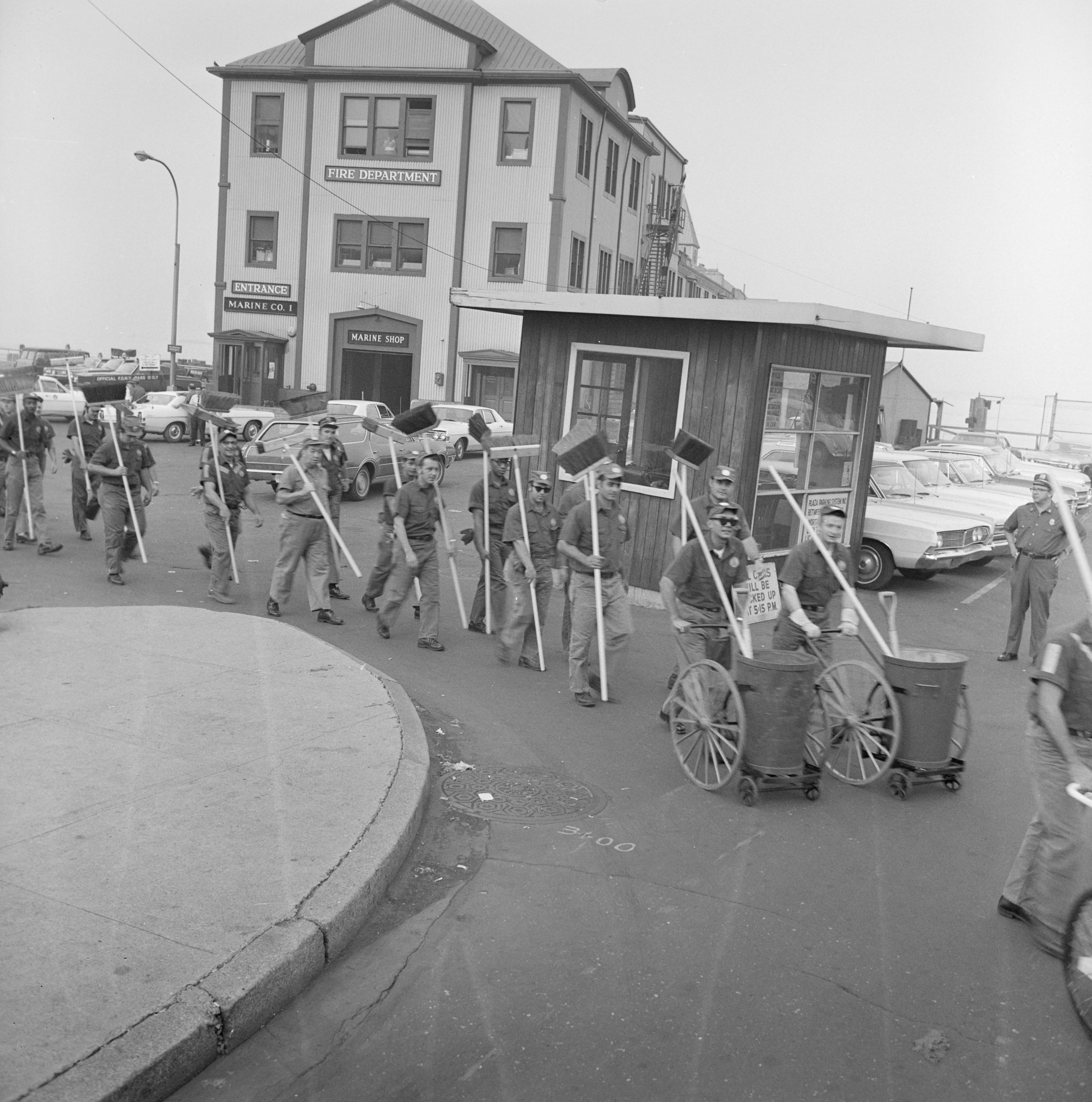 Sanitation workers in front of Pier A preparing to clean up after the parade, August 13, 1969. Department of Sanitation Collection, NYC Municipal Archives.