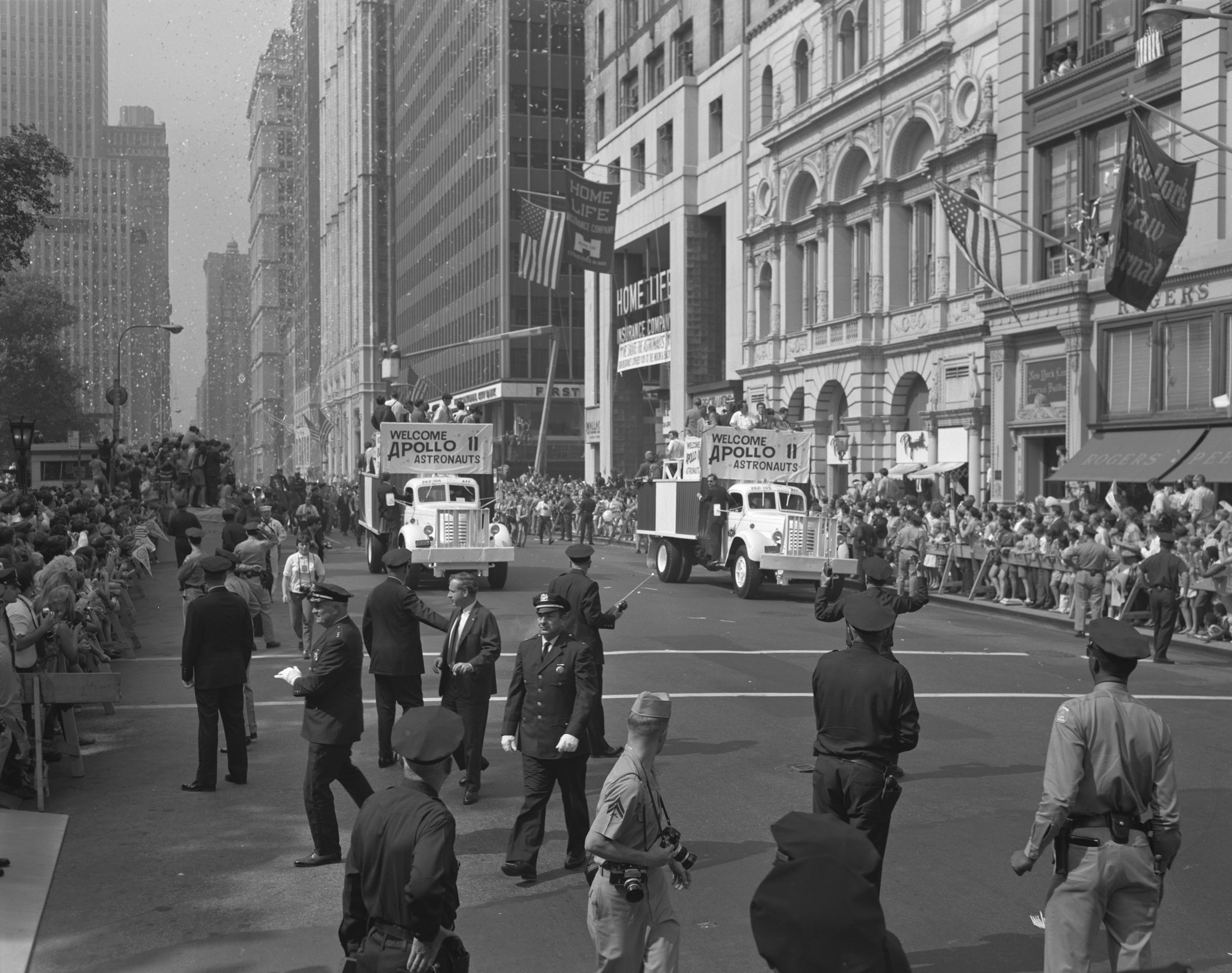 Press trucks lead the Apollo 11 Astronaut motorcade along Broadway approaching City Hall Park, August 13, 1969. NYPD Collection, NYC Municipal Archives.