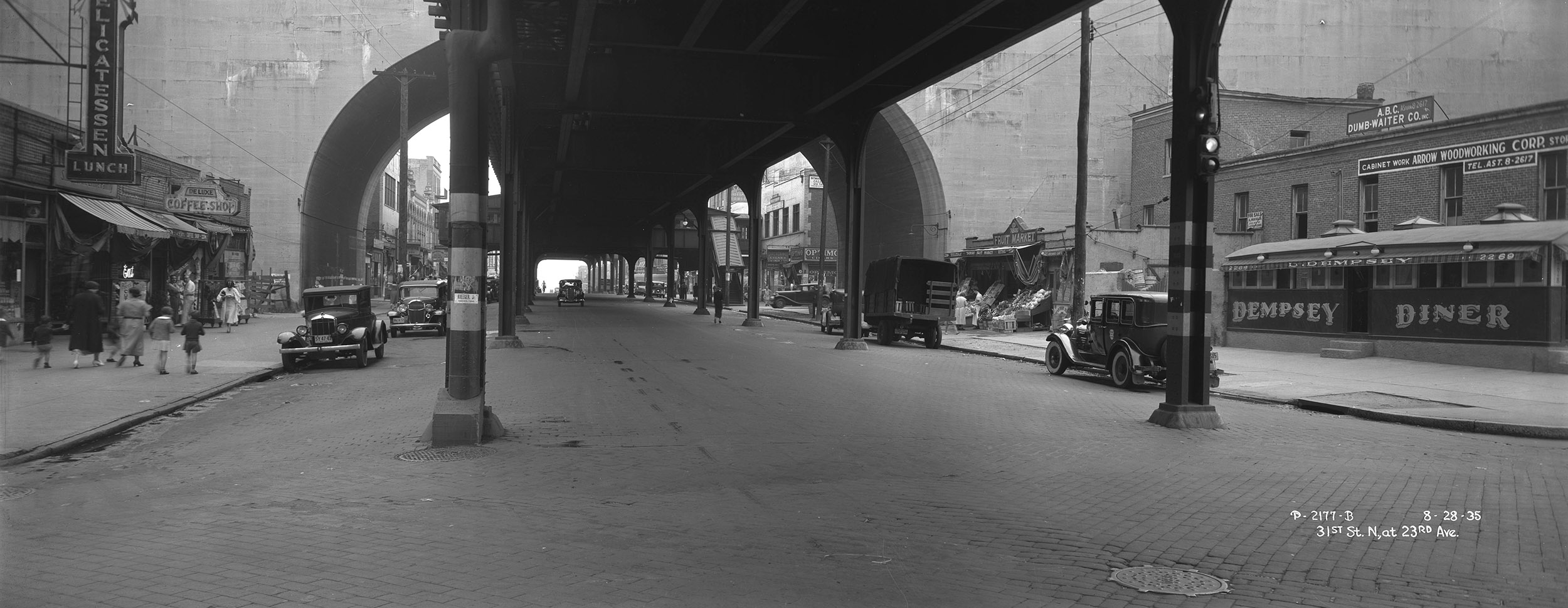 Under the elevated train, 31st Street, looking north at 23rd Avenue, Queens, August 28, 1935. Borough President Queens Collection, NYC Municipal Archives.
