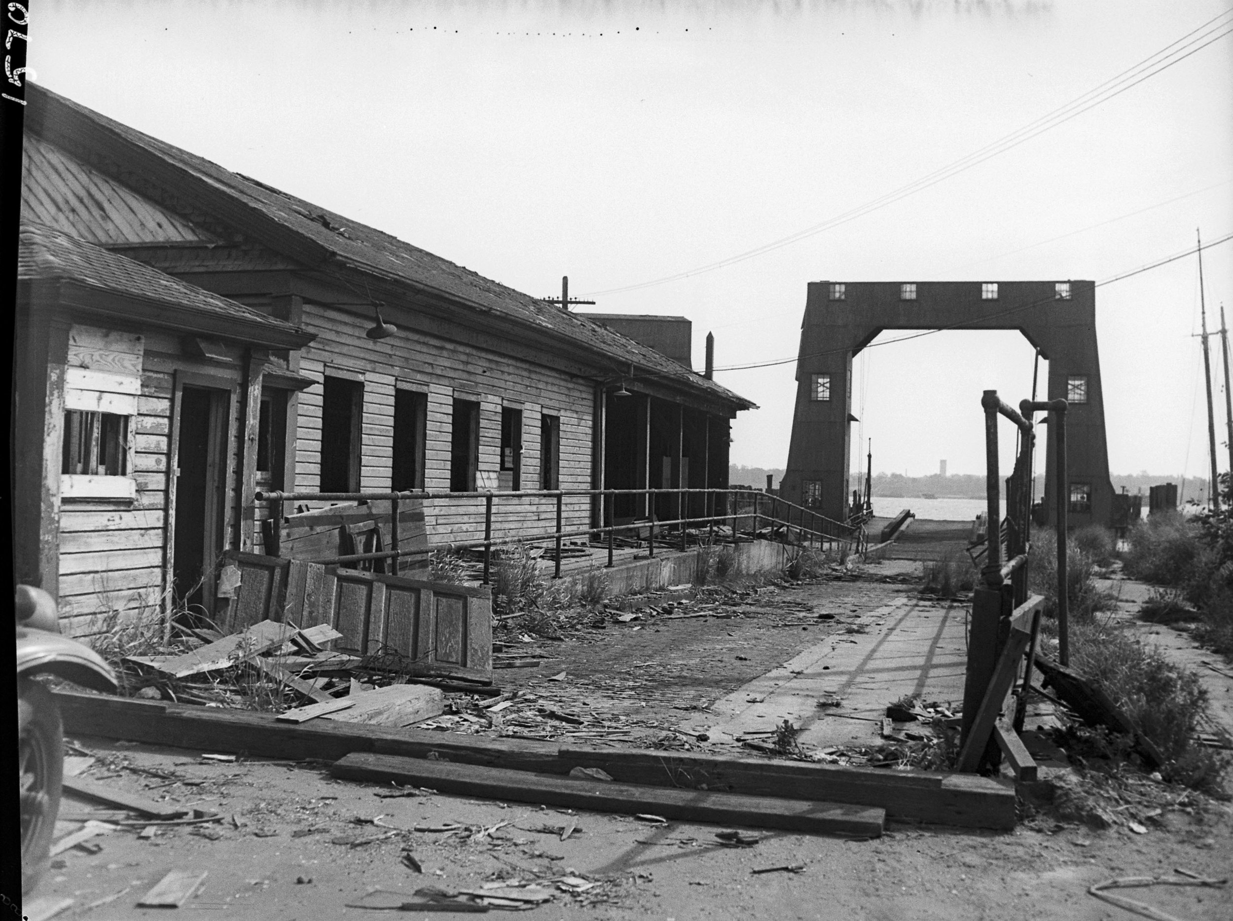 Clason Point Ferry House in disrepair, 1951. This Municipal Ferry route was in operation from 1921-1939. It ran between Clason Point in the Bronx and College Point in Queens. Department of Marine and Aviation photographs. NYC Municipal Archives.