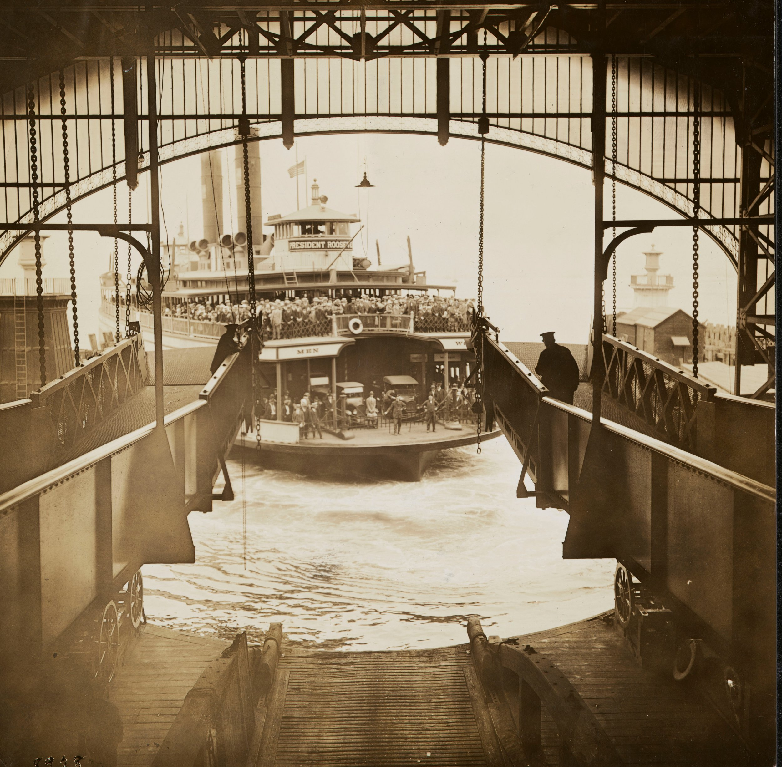"Cars and passengers aboard the Staten Island Municipal Ferry ""President Roosevelt,"" arriving in Staten Island, June 8, 1924. Department of Bridges, Plant & Structures photograph, NYC Municipal Archives."
