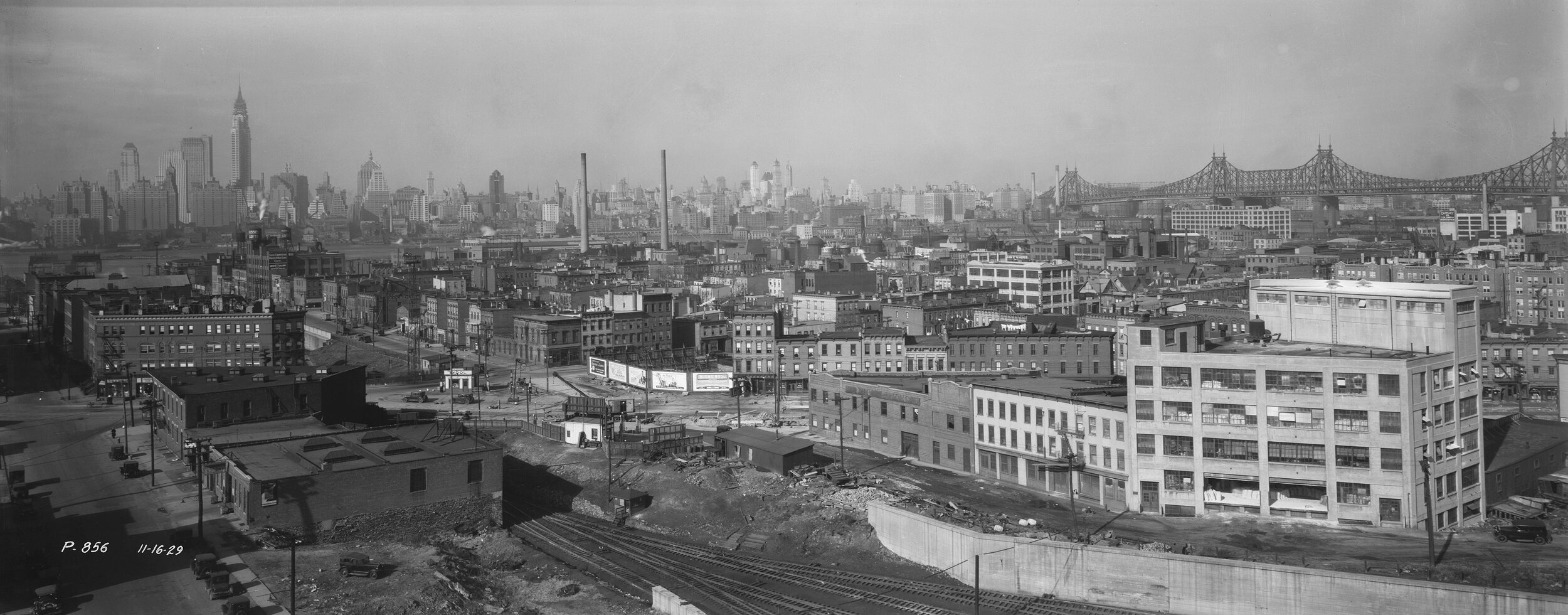 P-856:  Elevated view of Long Island City south of the Queensboro Bridge (visible at right), looking toward Manhattan, November 16, 1929. Borough President Queens Collection, NYC Municipal Archives.