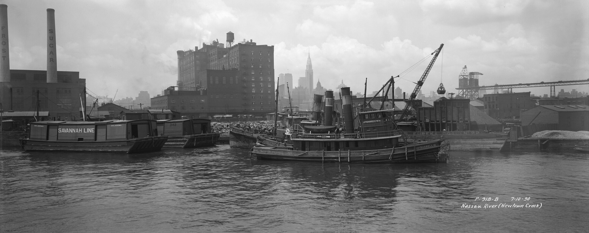P-918-b:  Nassau River (Newtown Creek), July 10, 1930. The Chrysler Building is visible in the distant Manhattan skyline. Borough President Queens Collection, NYC Municipal Archives.