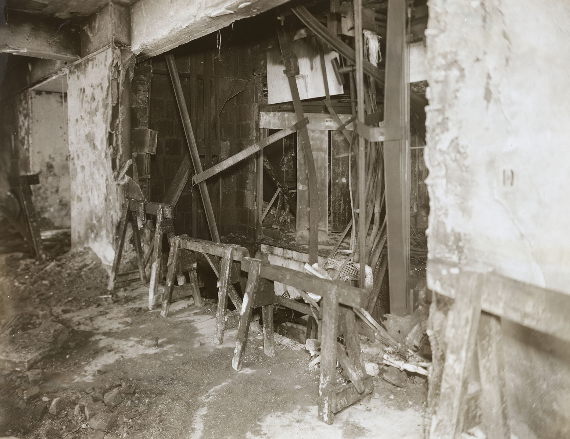 Empire State Building Disaster: Interior, 79th Fl. 12:55 pm, July 28, 1945. Hole in south wall where plane crashed into elevators. Mayor LaGuardia Collection, NYC Municipal Archives.