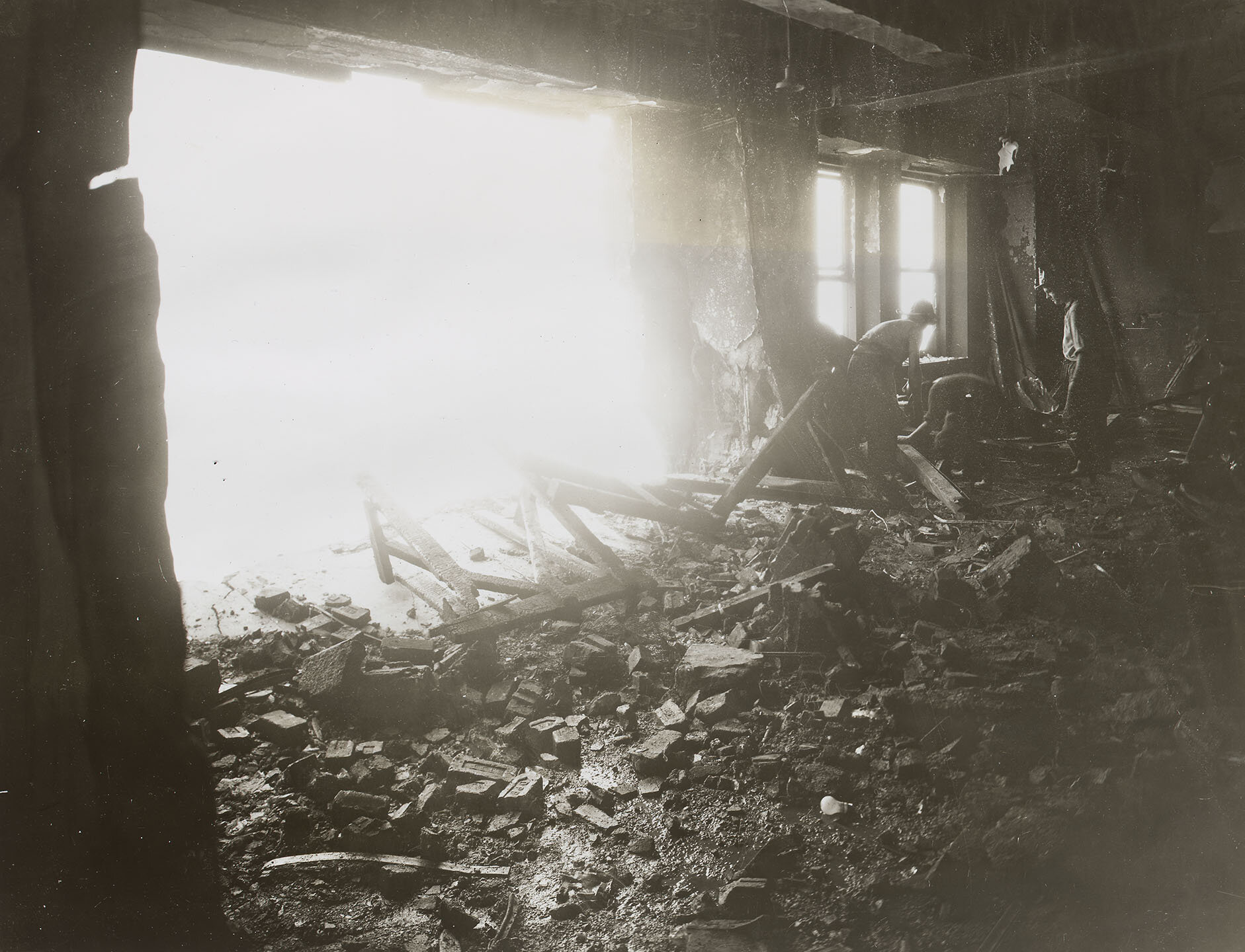 Empire State Building Disaster: Interior, 12:40 pm; 79th Floor, showing hole in wall where plane crashed, July 28, 1945. Mayor LaGuardia Collection, NYC Municipal Archives.