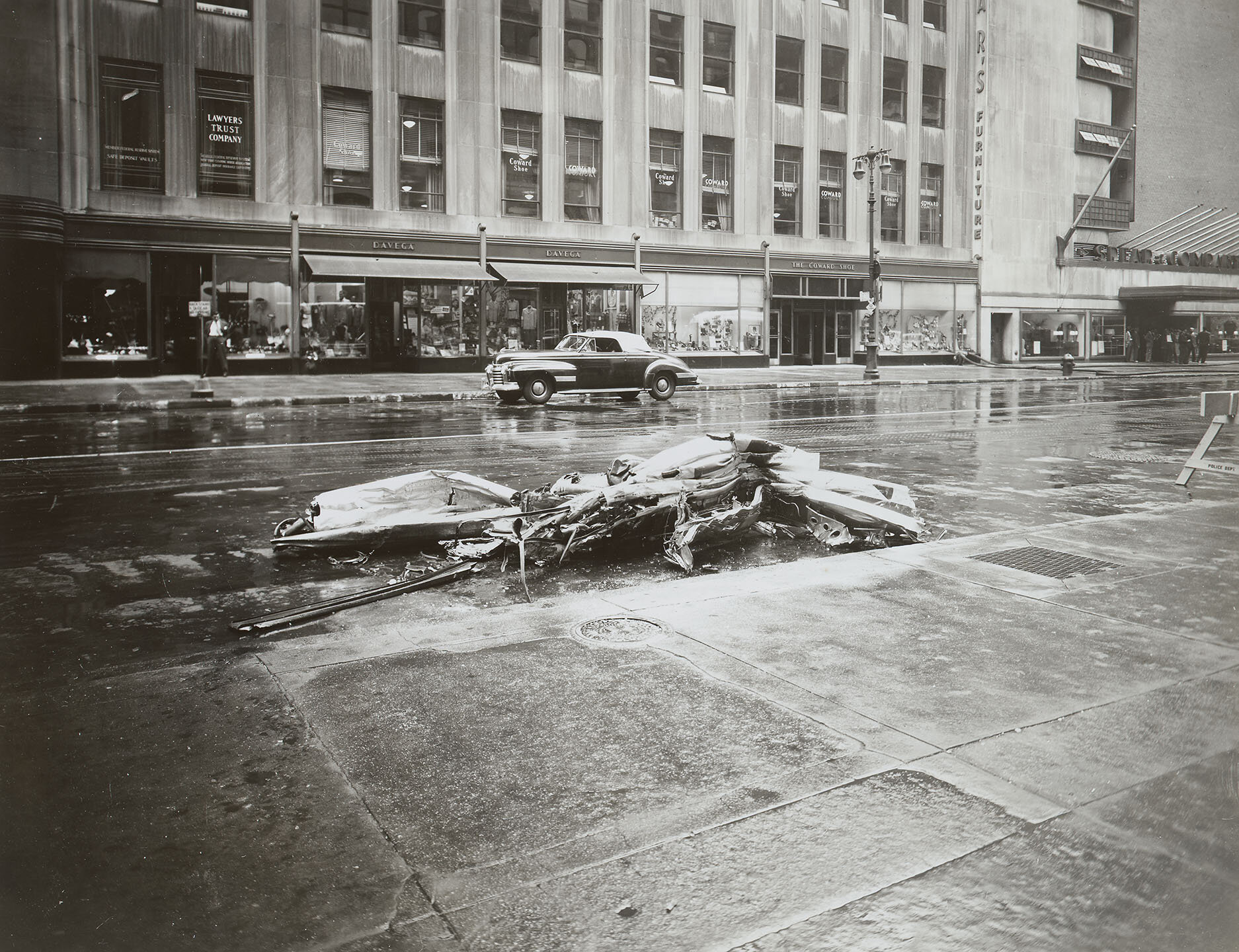 Empire State Building Disaster: 34th Street, showing parts of plane on N side of street; 1:20 pm, July 28, 1945. Mayor LaGuardia Collection, NYC Municipal Archives.