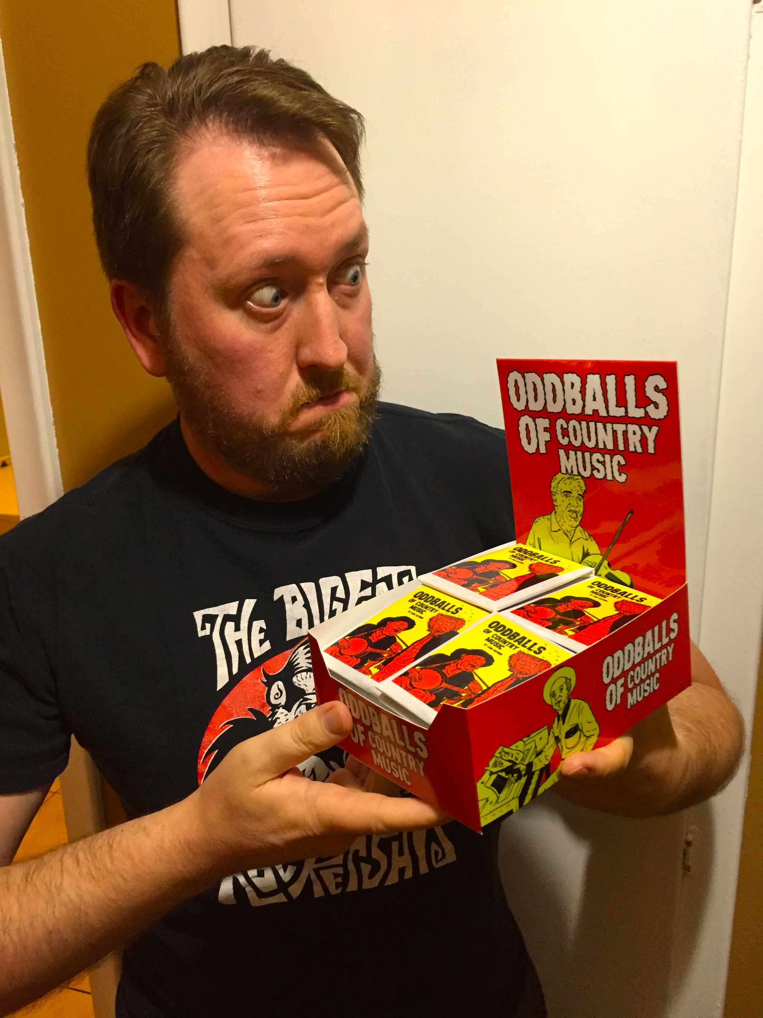 Artist Cam Hayden with his Oddballs of Country Music sketch cards.   (Photo credit: Chris Doucher/GeekNerdNet)